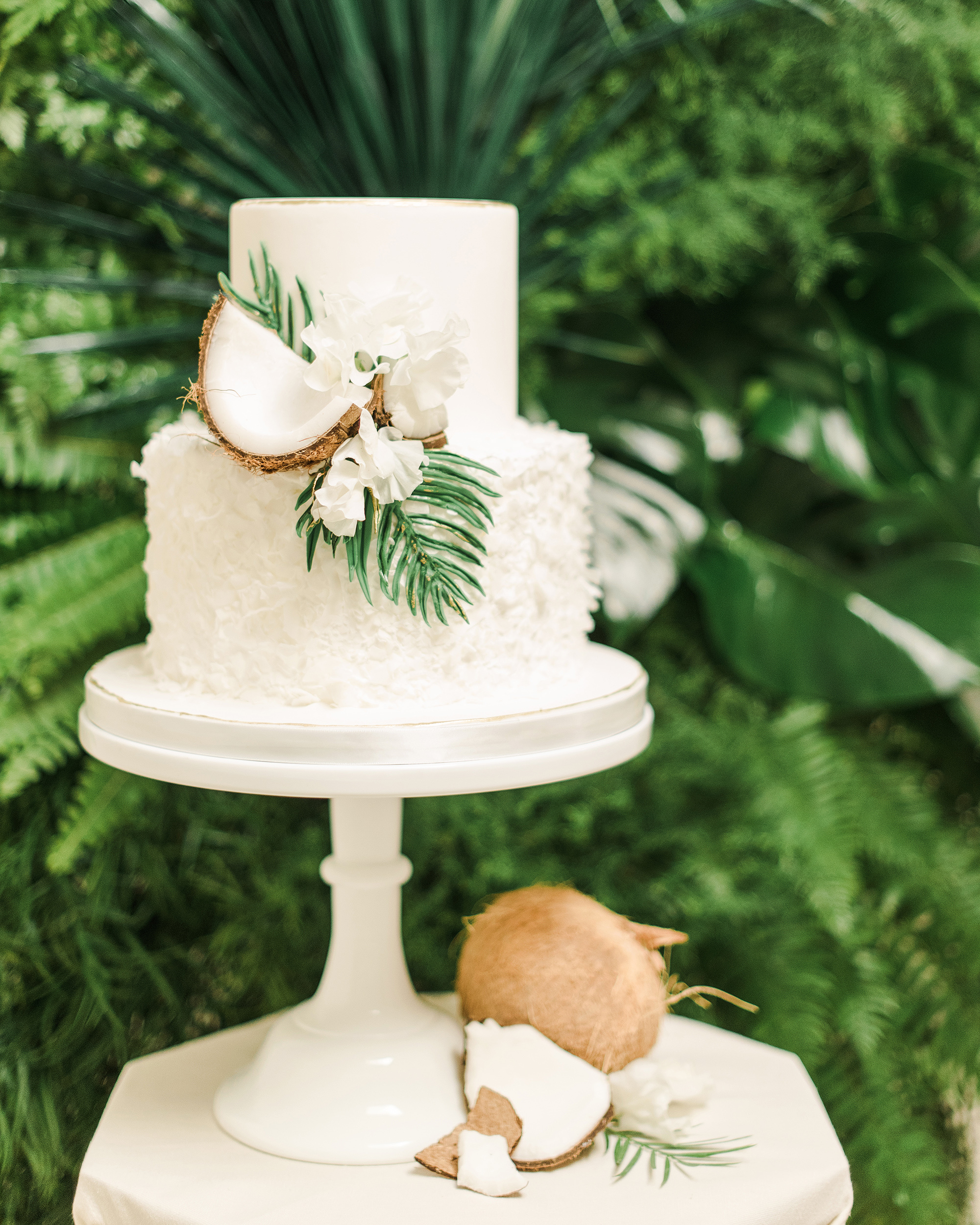 tropical wedding cake with coconut details