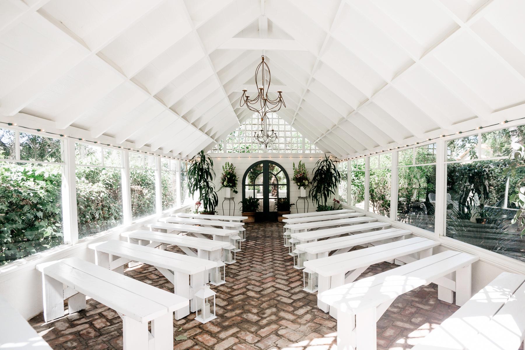 air bnb wedding venue white backyard green house set for ceremony