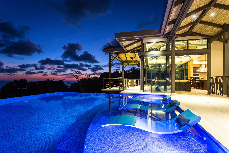 air bnb wedding venue blue tile swimming pool at dusk