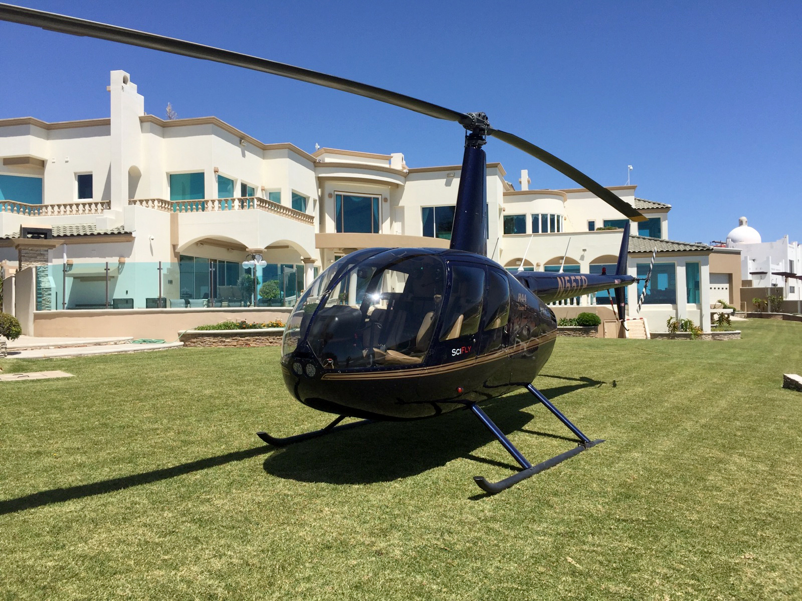 air bnb wedding venue mexican beachfront mansion with helicopter on lawn