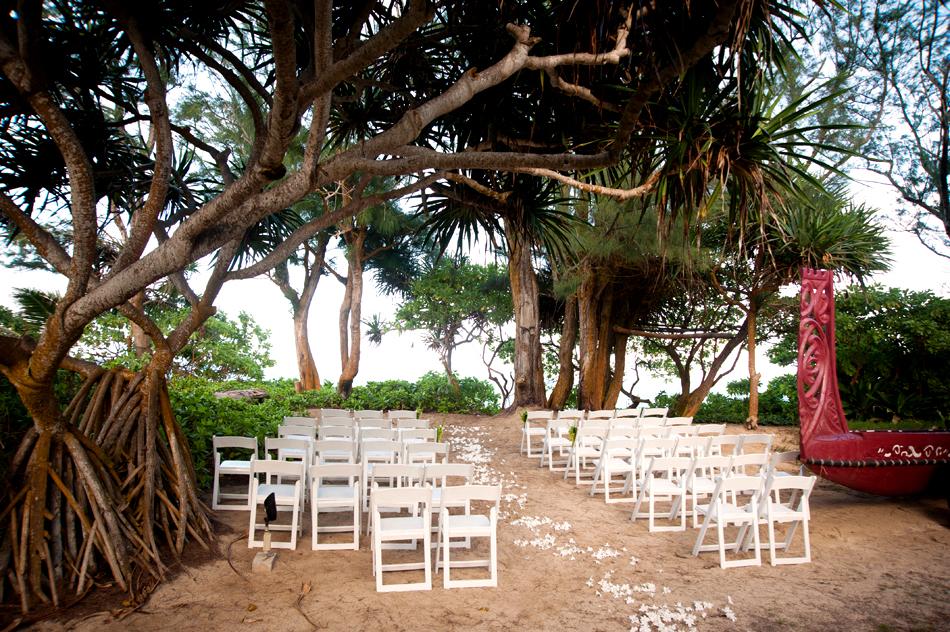 air bnb wedding venue white chairs on beach