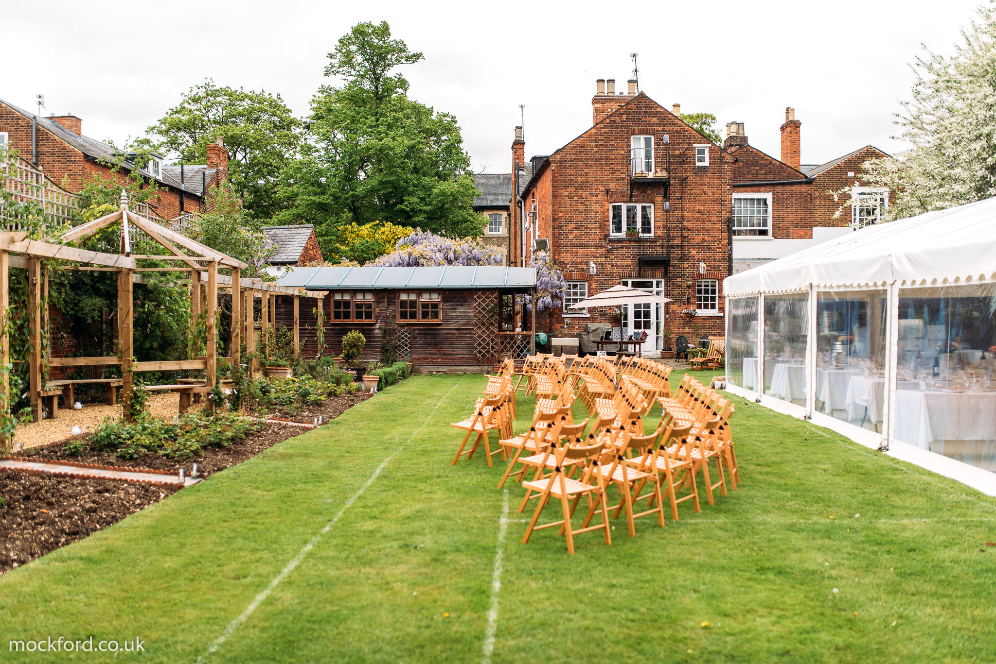 air bnb wedding venue chairs set up in traditional english garden