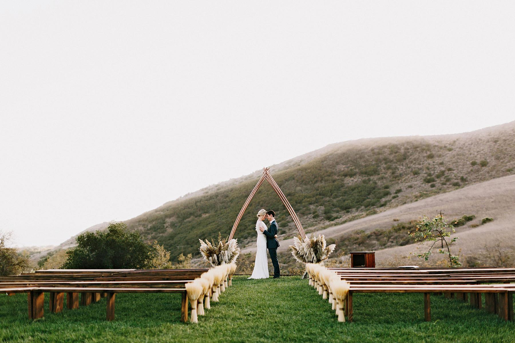 bride and groom at el capitan canyon in california