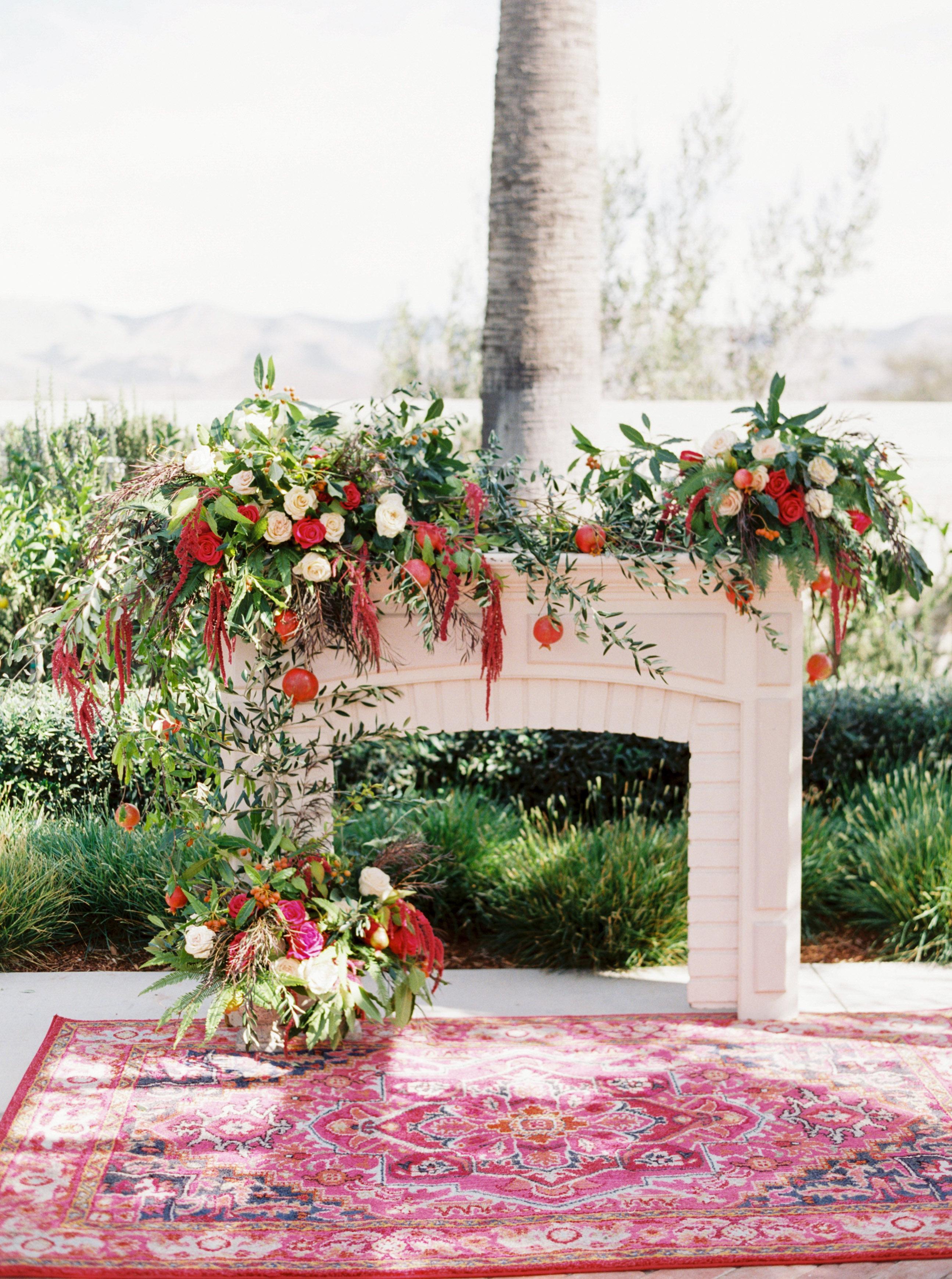 freestanding fireplace backdrop floral arrangement