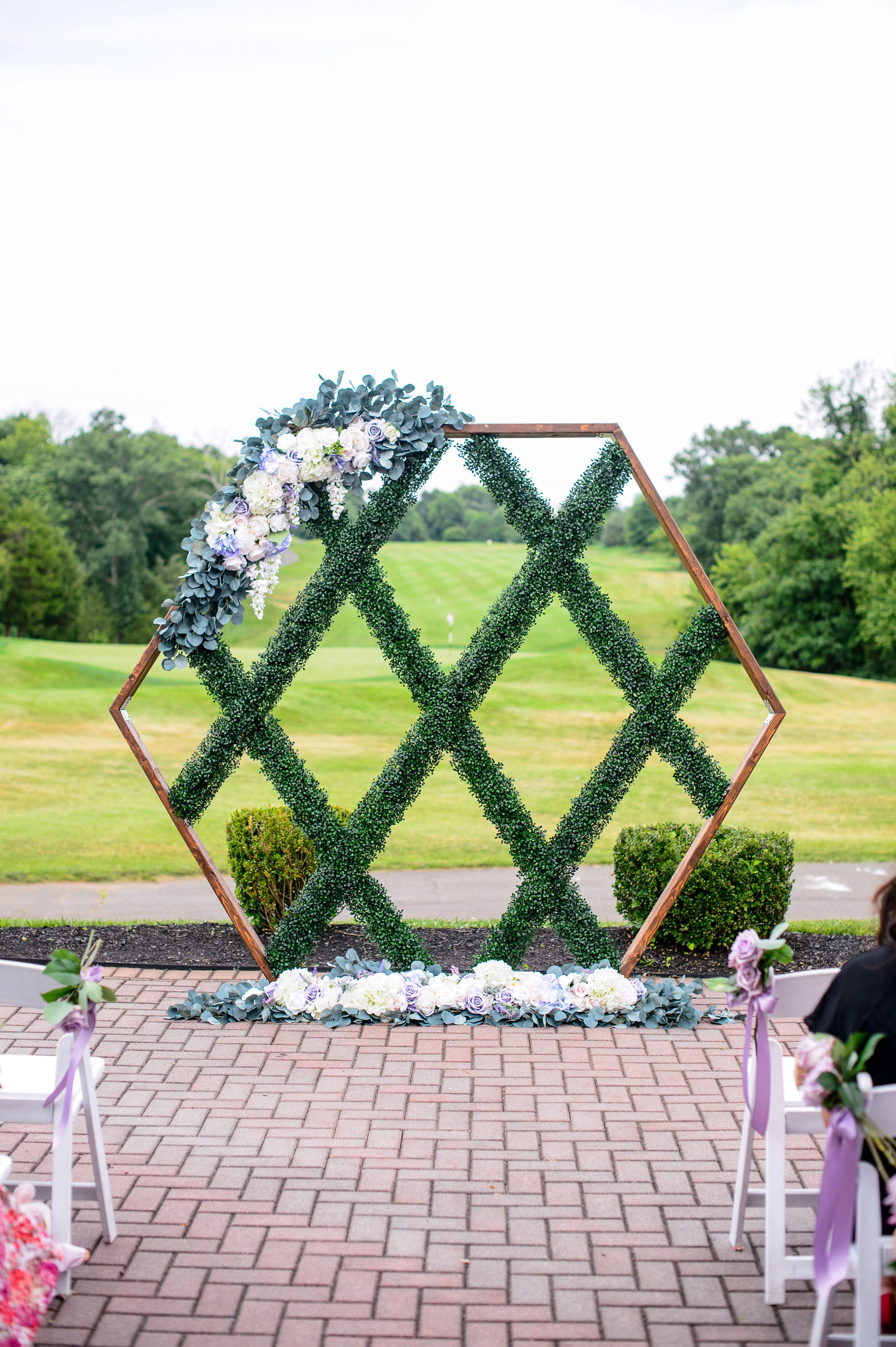 wedding backdrop installation geometric floral greenery