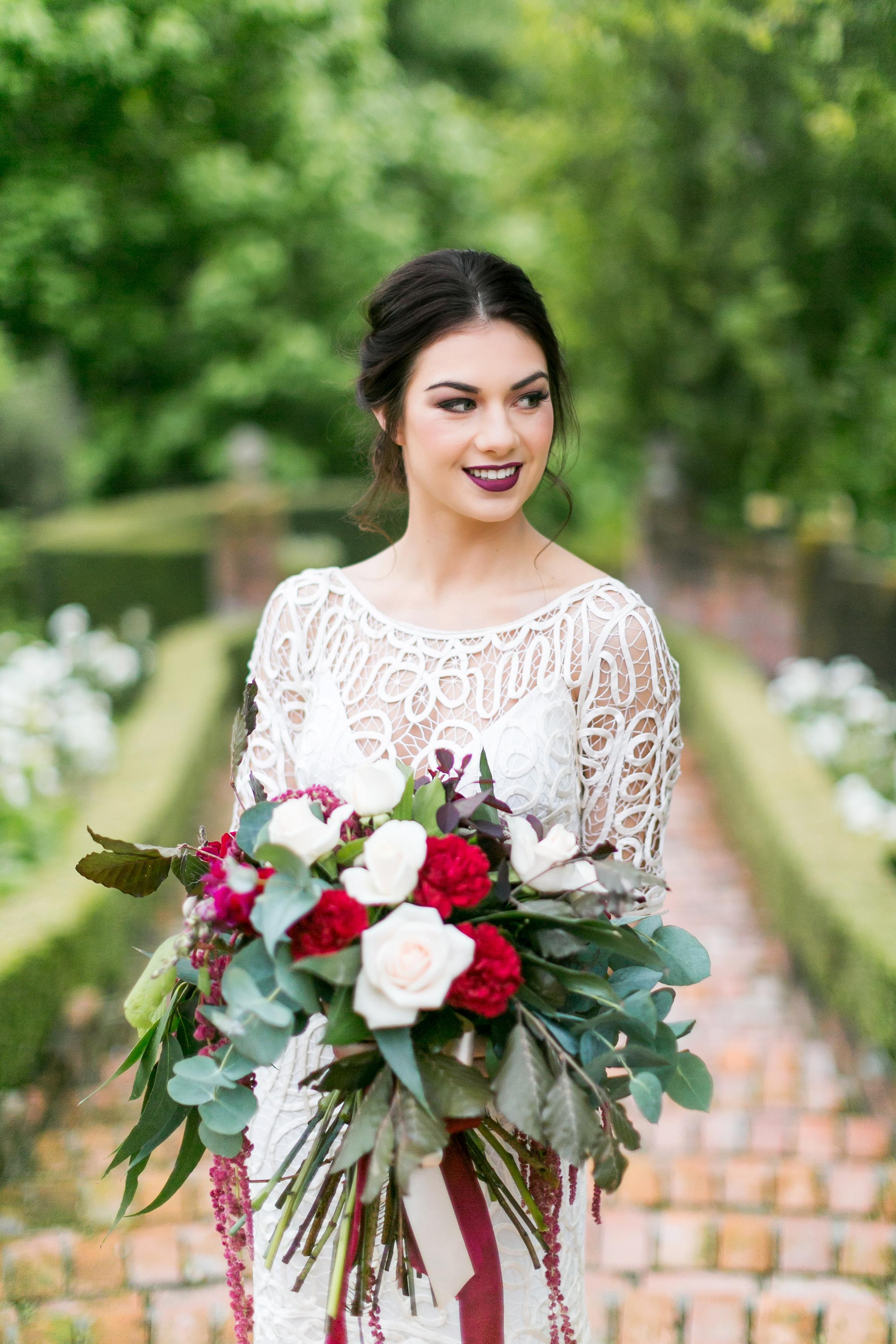 bold lipstick bride with bouquet