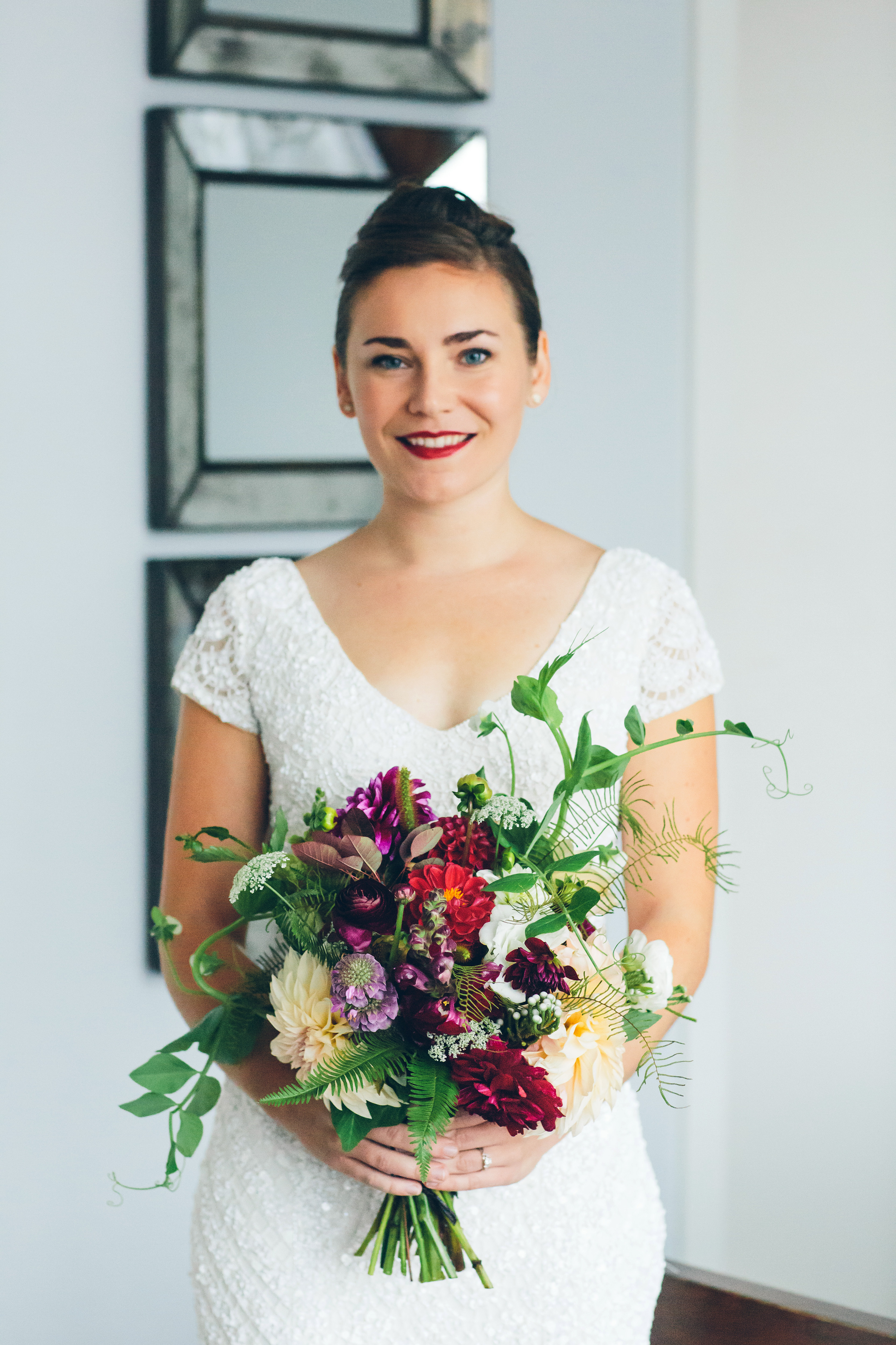 bold lipstick bride with colorful bouquet