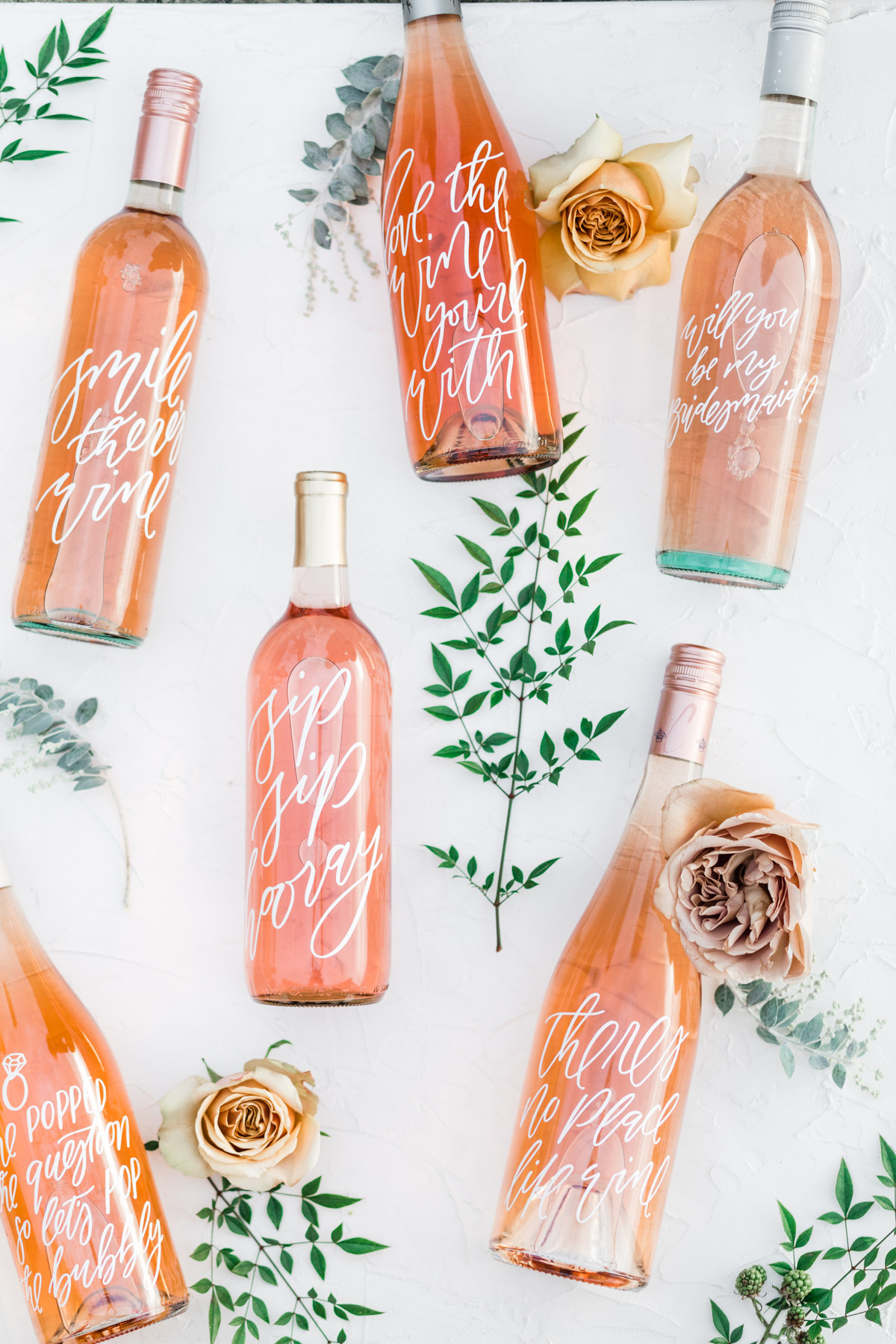 calligraphed bottles of rose