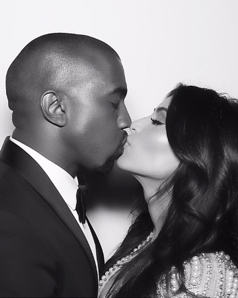 kim-kardashian-kanye-west-photo-booth-kiss-0516.jpg