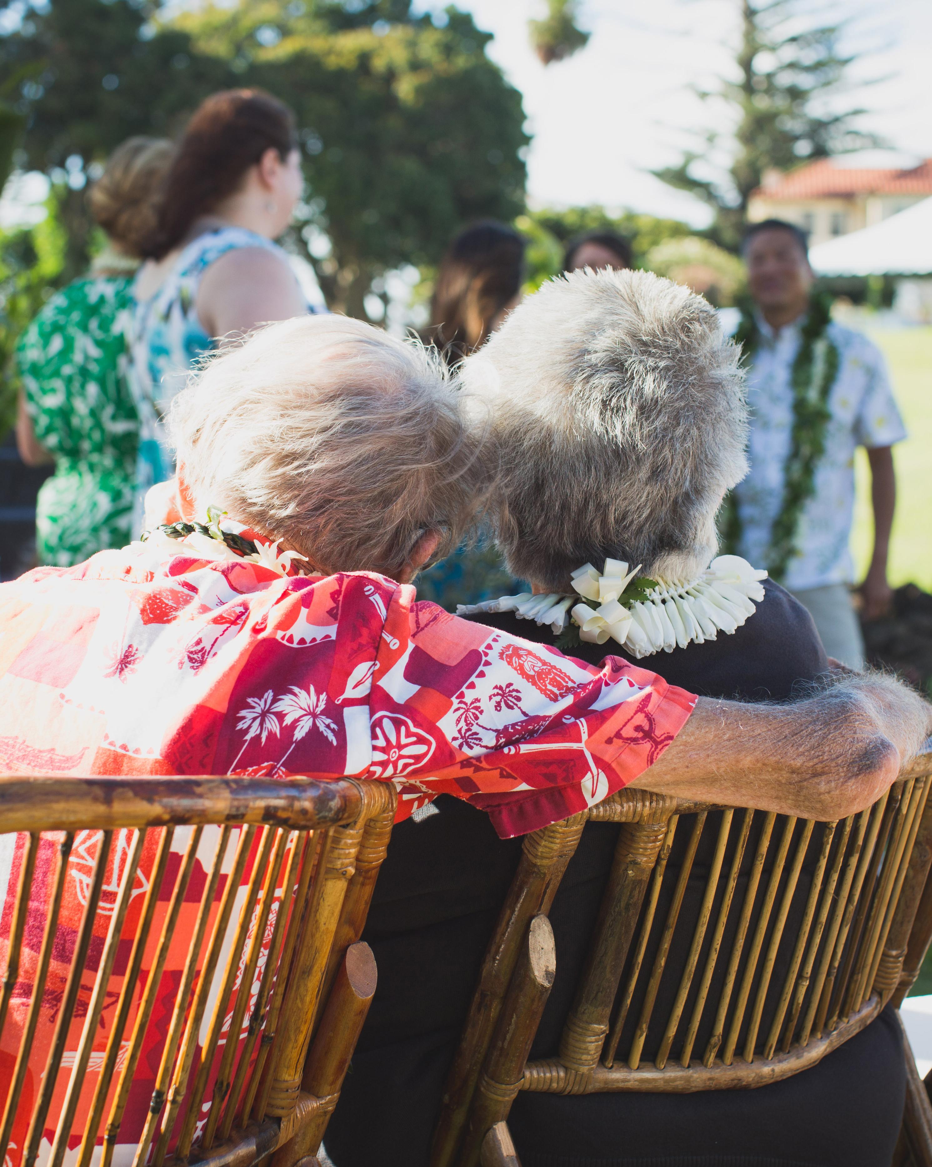 Grandparents Sitting Together at Ceremony