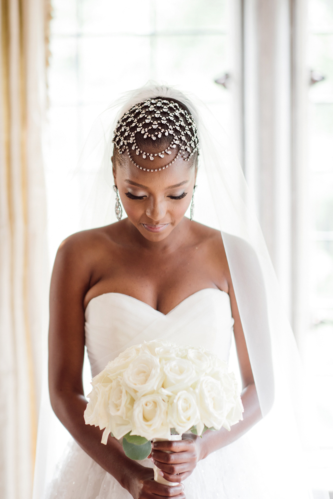 bride with sleek updo and headpiece