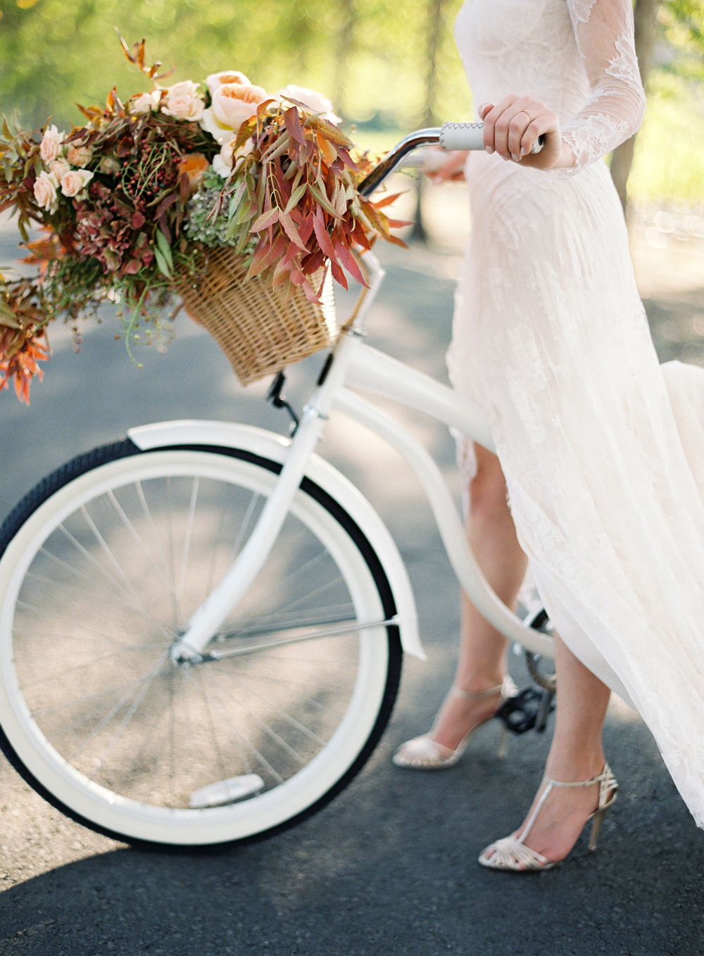 fall wedding flowers bride with bouquet on bike