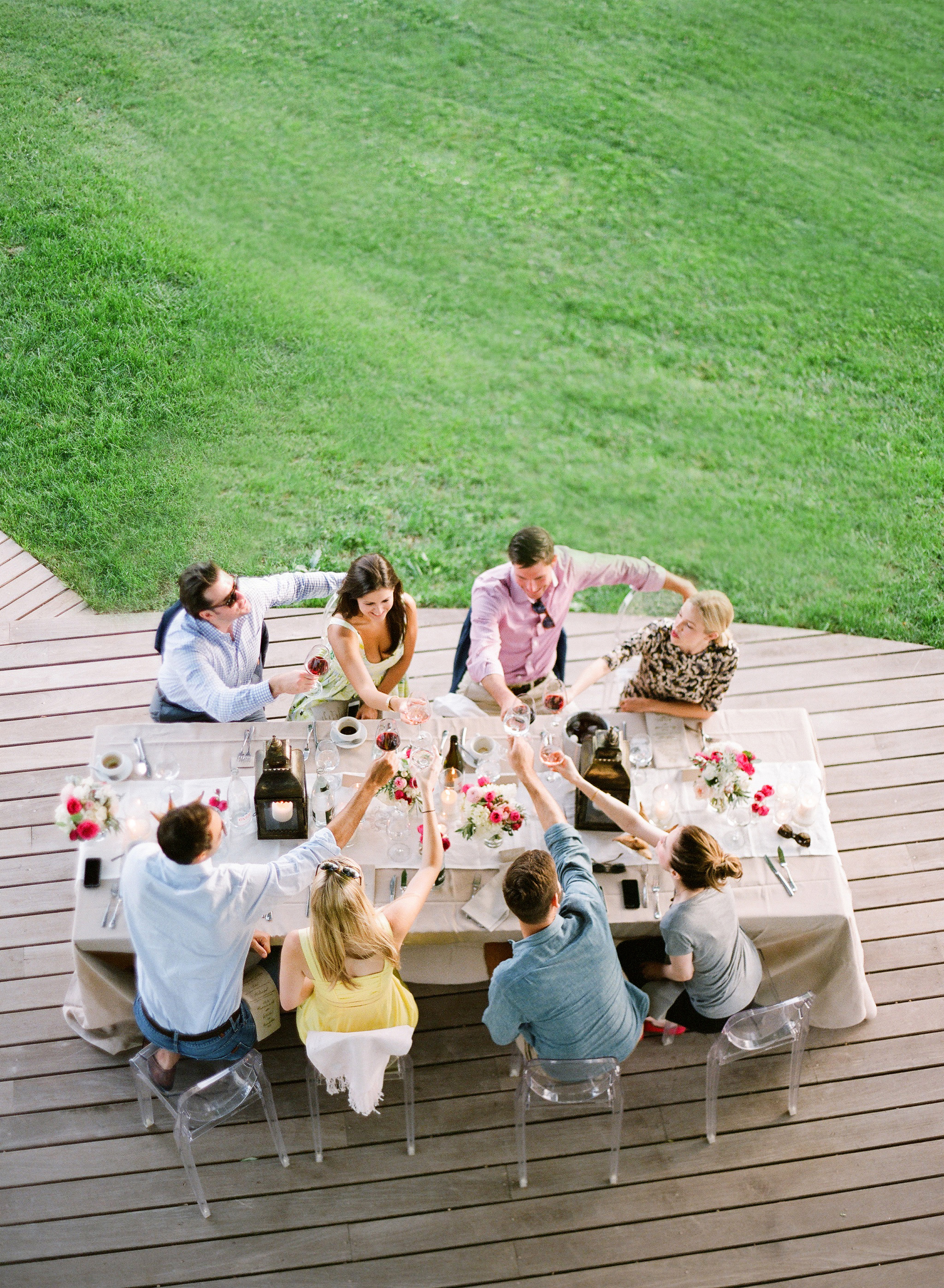 engagement party people sitting around table drinks cheers