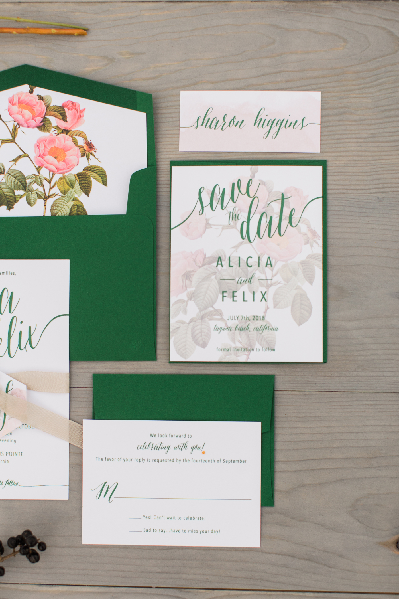 green and white stationary save the dates with pink floral design