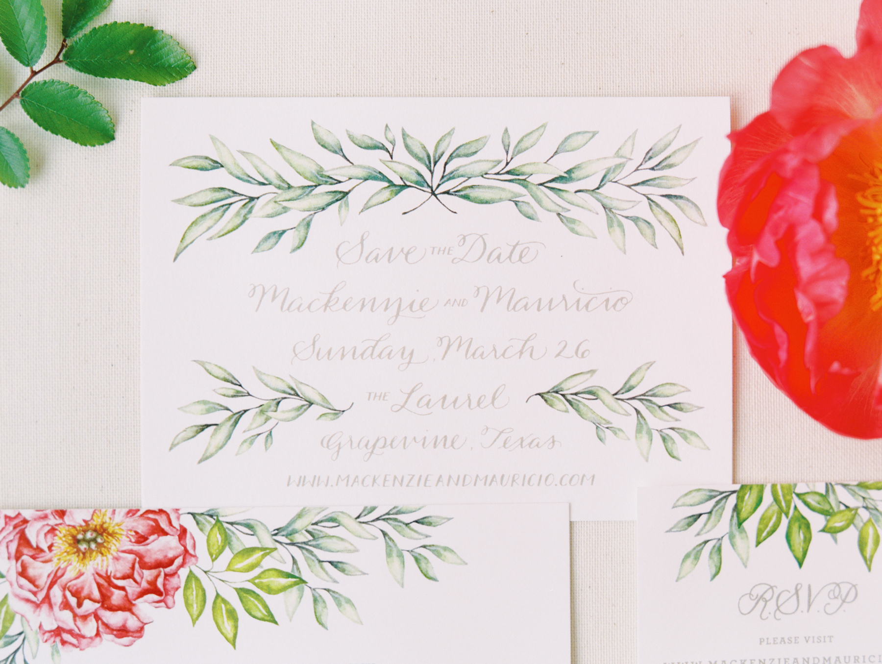 off white stationary save the dates with greenery design accents