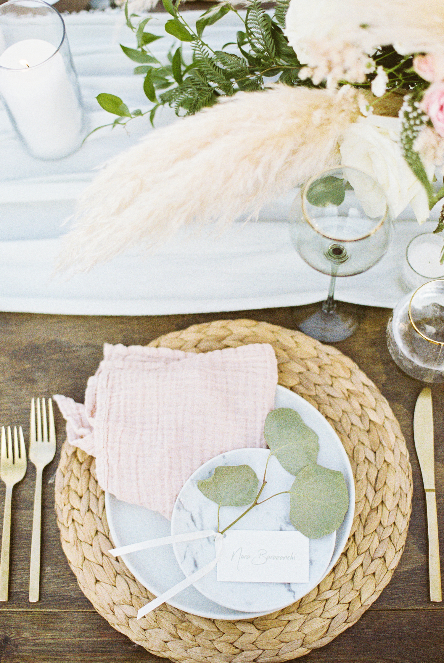 spring place setting with pastel pink napkin