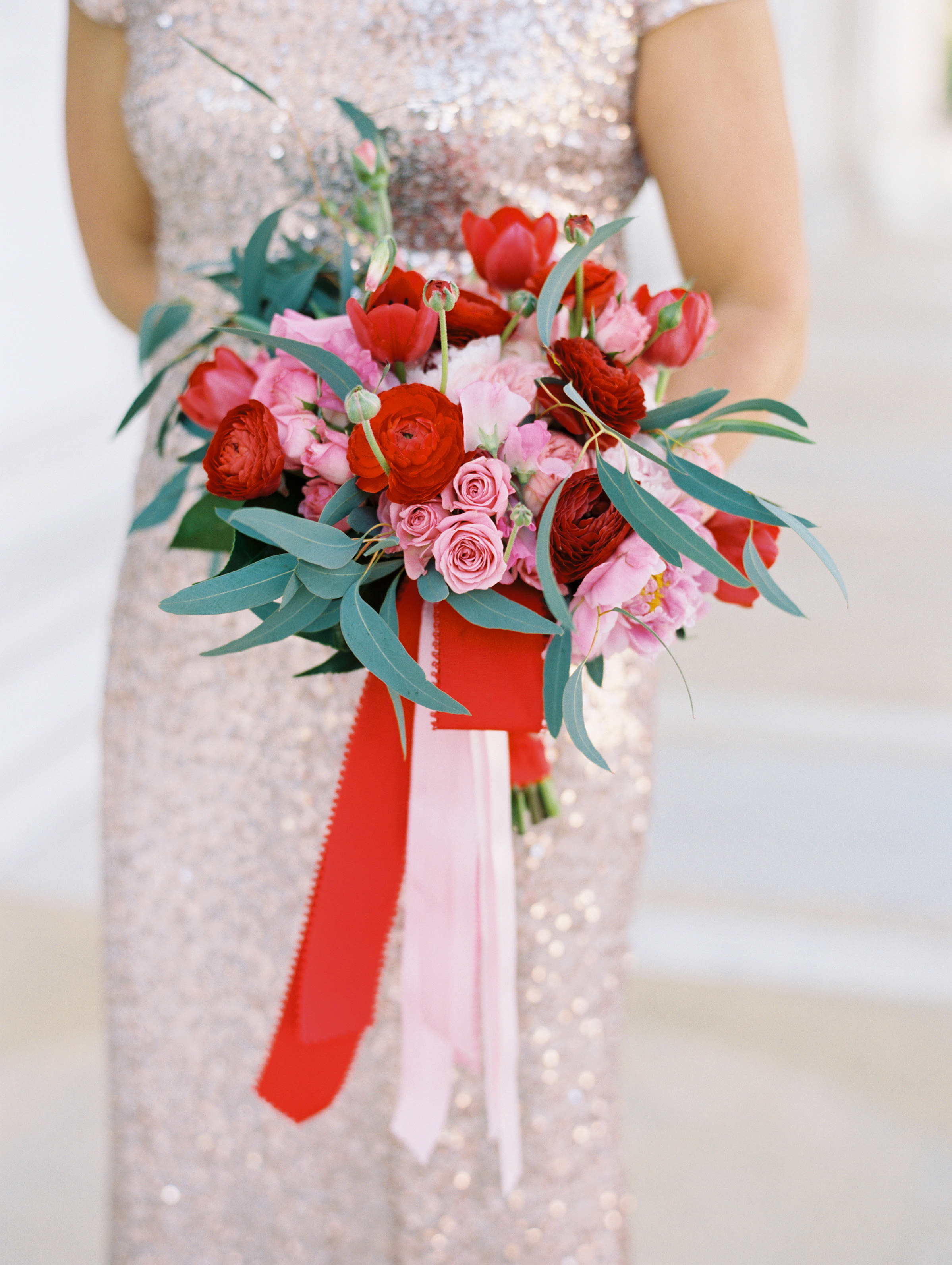 wedding bouquet with red and pink garden roses and tulips