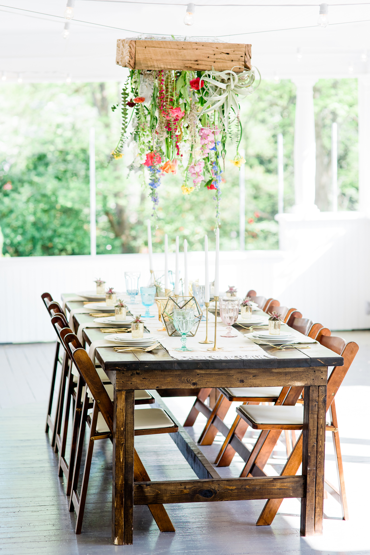 upside-down hanging flower box above table