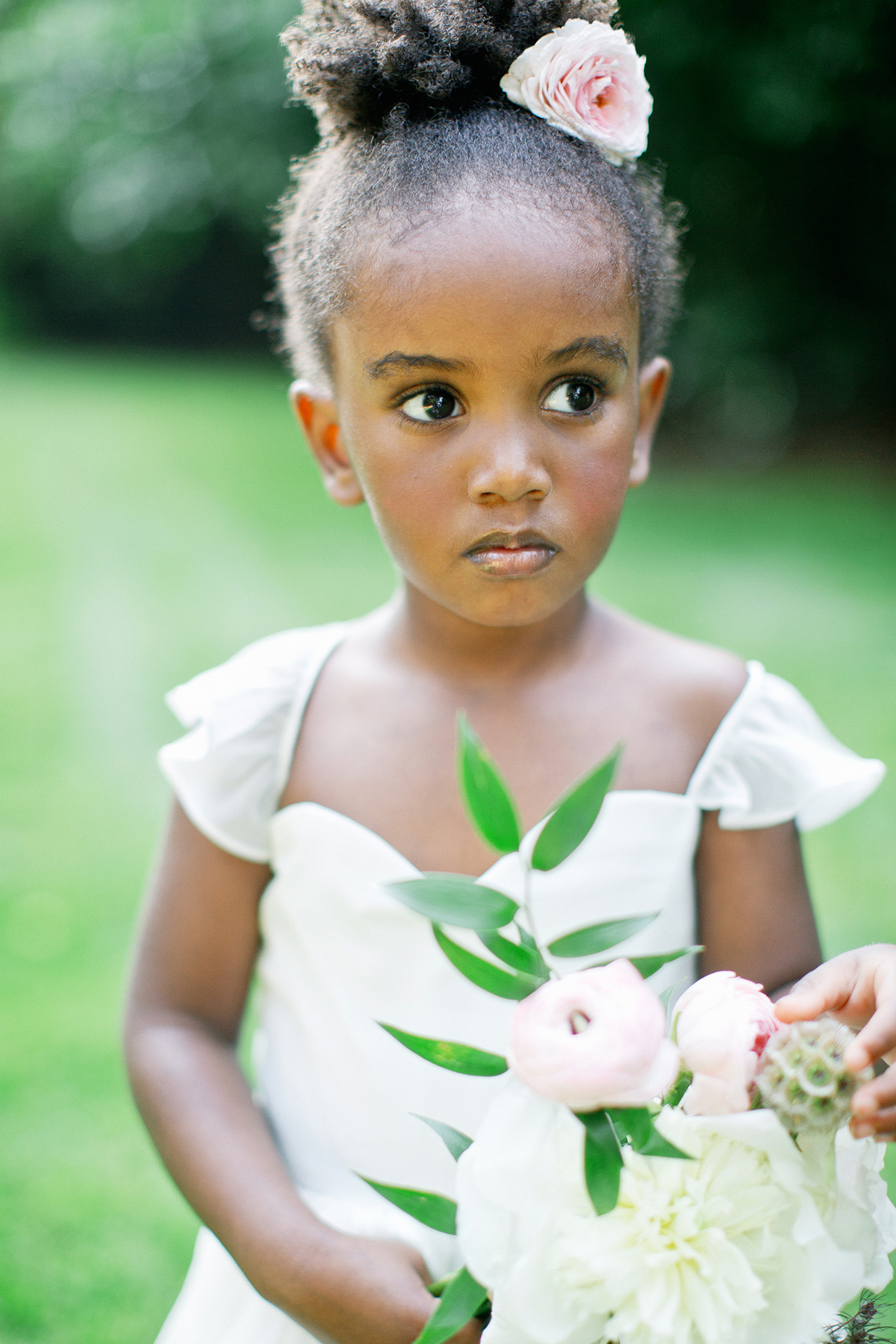 flower girl with bouquet
