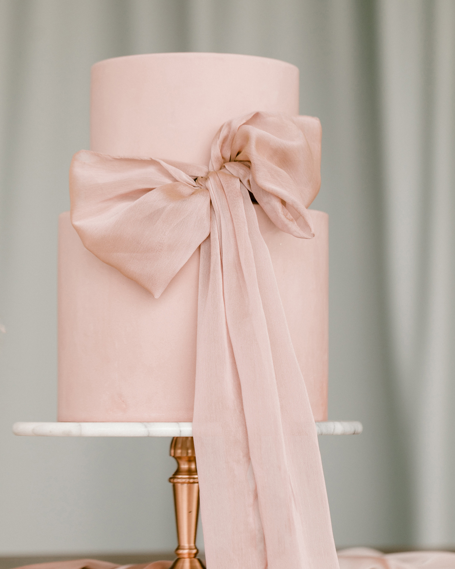 ribbon wedding ideas pink ribbon tied around pink wedding cake
