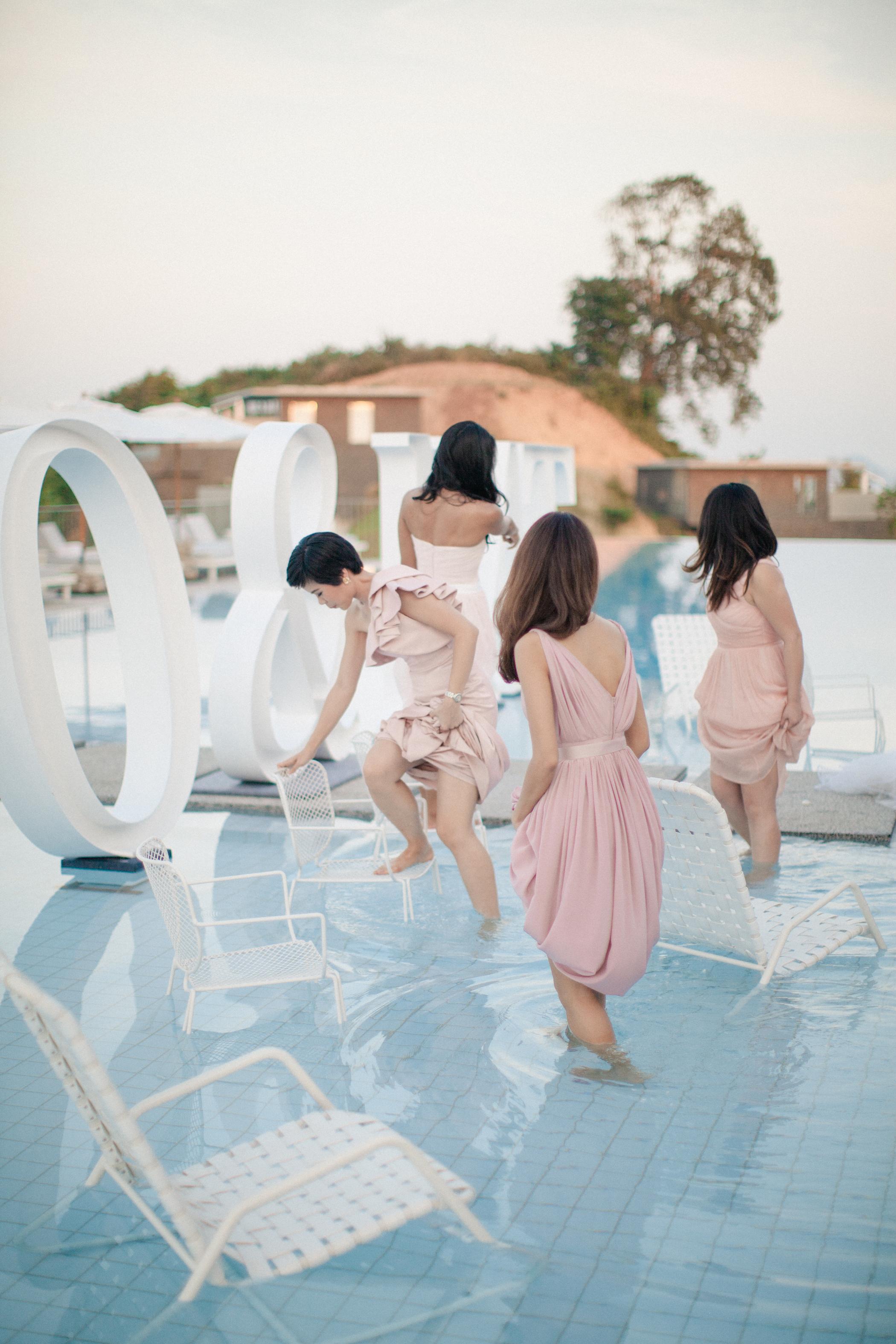 bridesmaids in pool