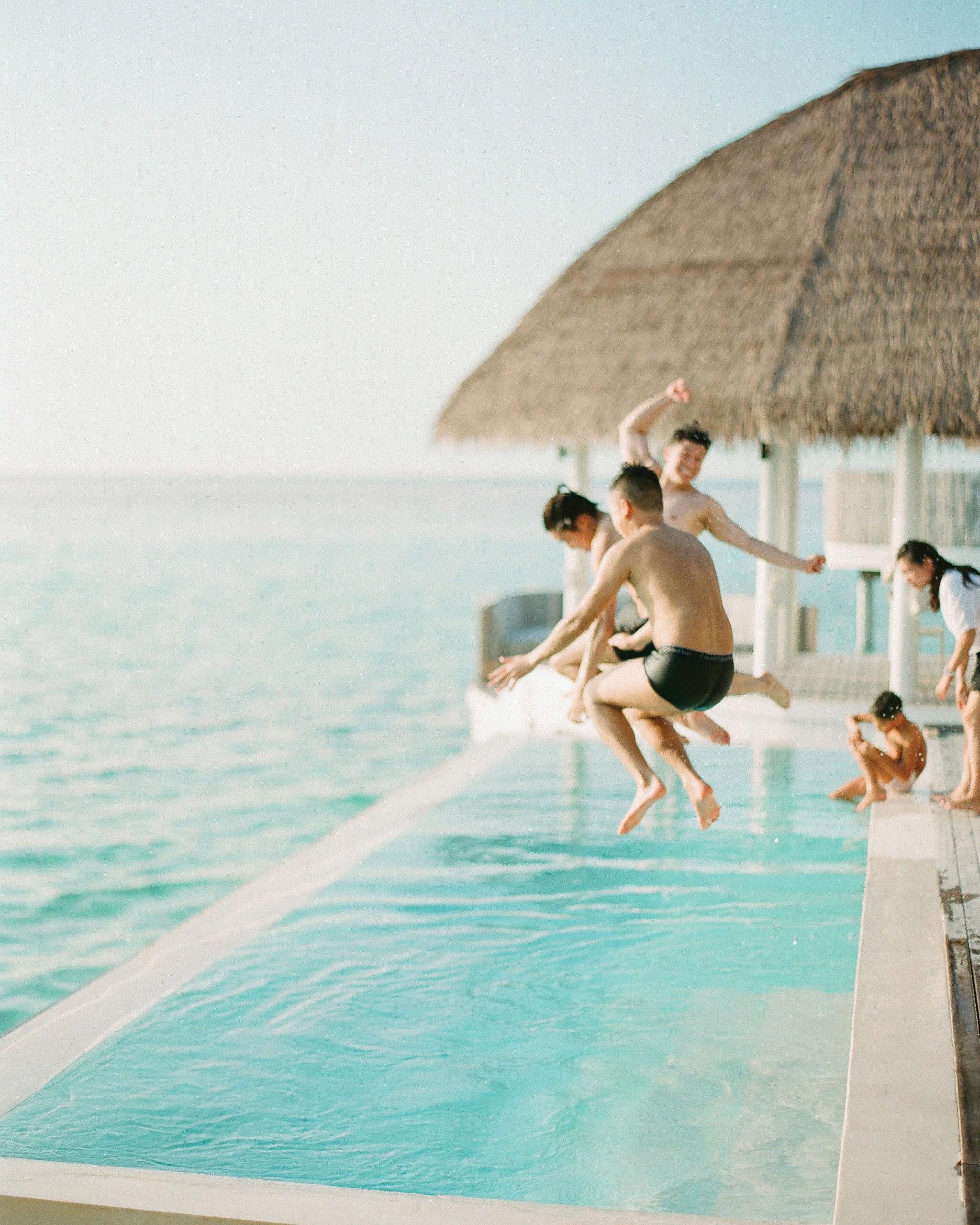 peony-richard-wedding-maldives-jumping-in-pool-0467-s112383.jpg