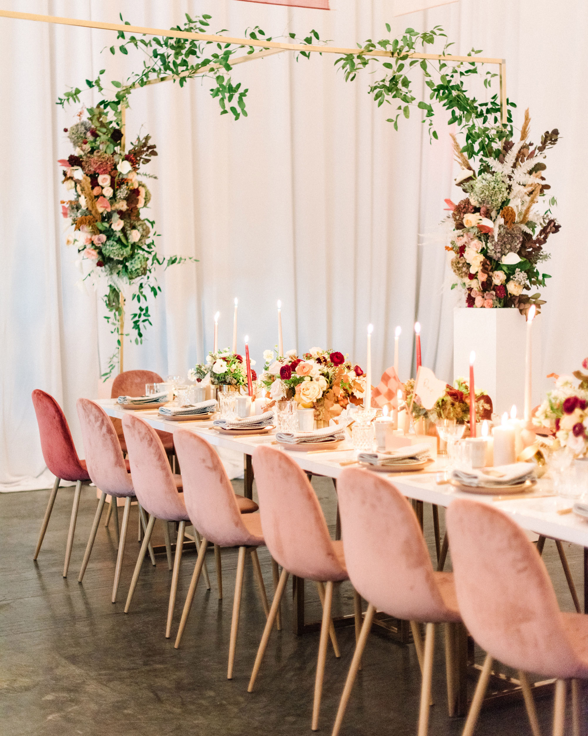 floral arch pink chairs long white table reception decor