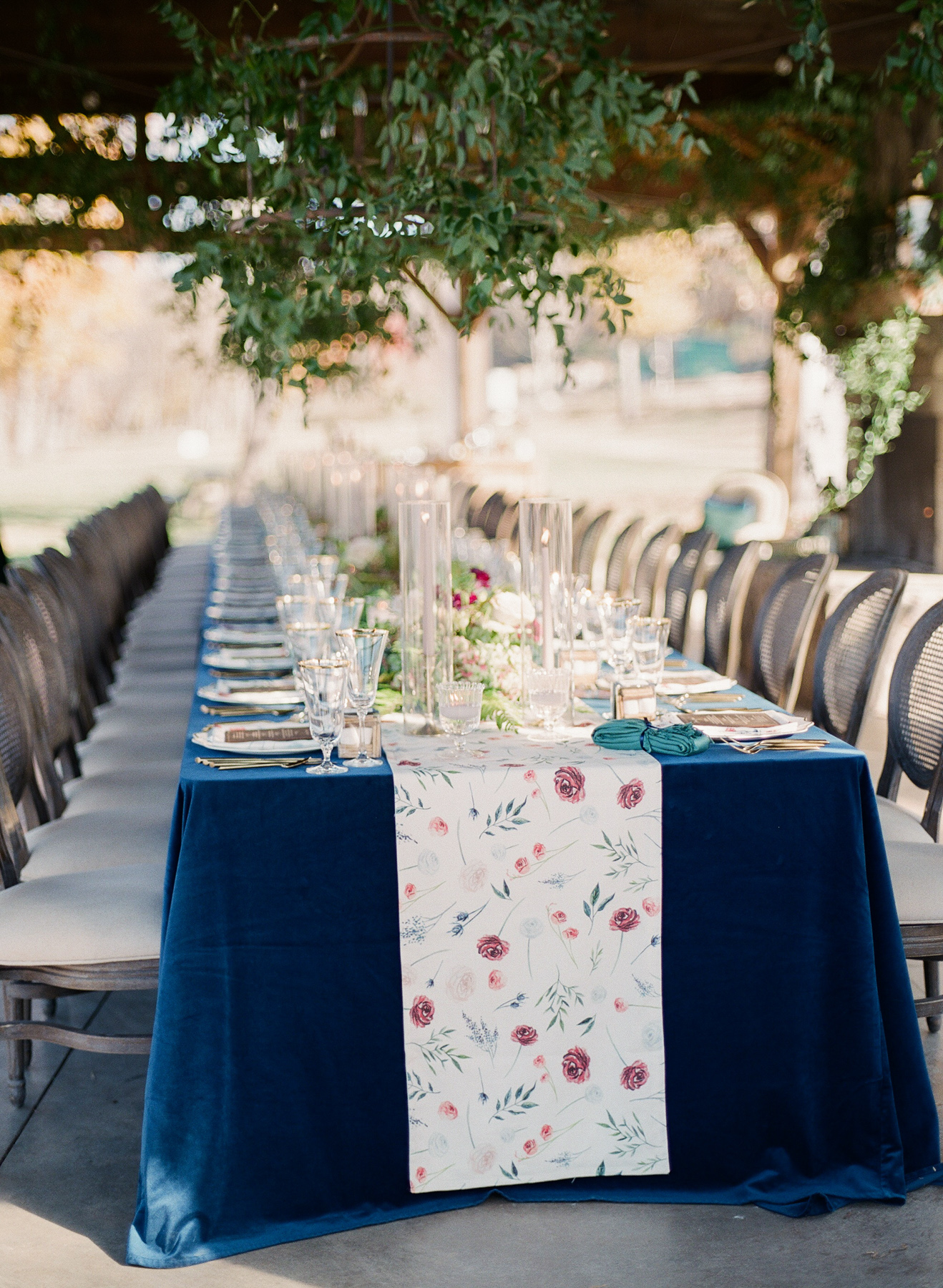 single long reception table with blue linen and velvet