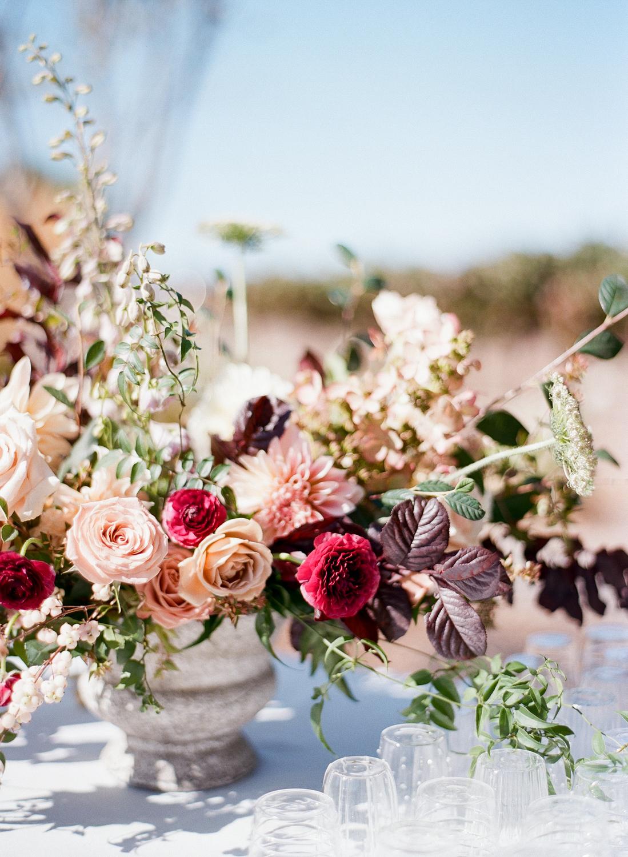 centerpiece with magenta garden roses