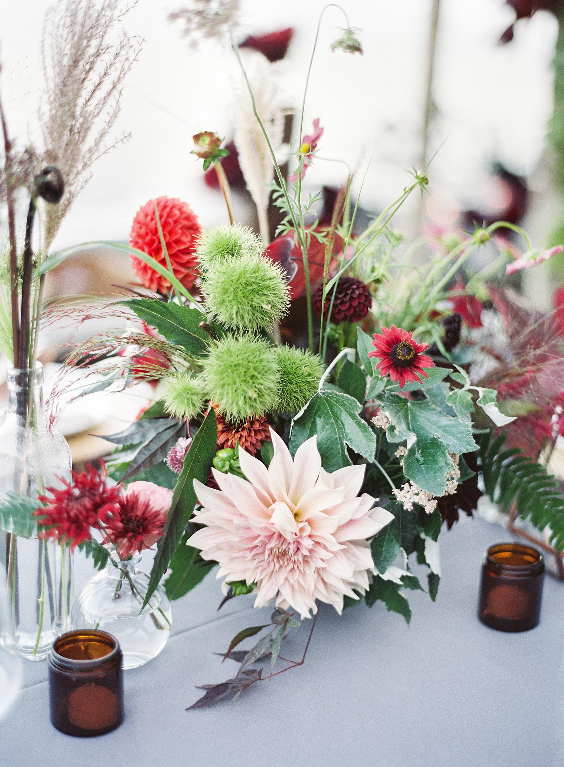 jewel-toned centerpiece with blush dahlia