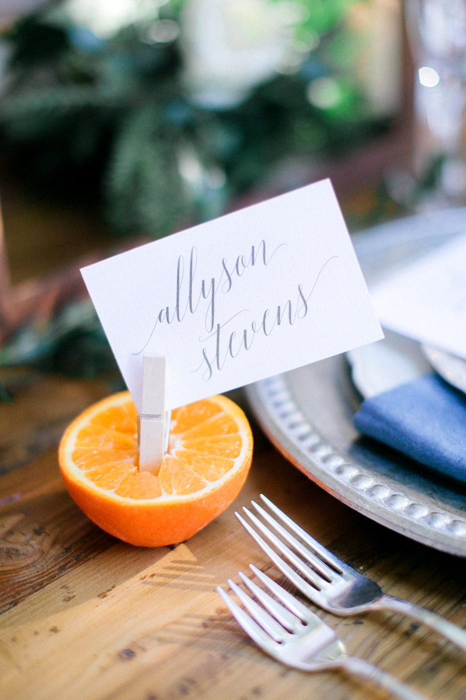 halved orange with clothes pin place card holder