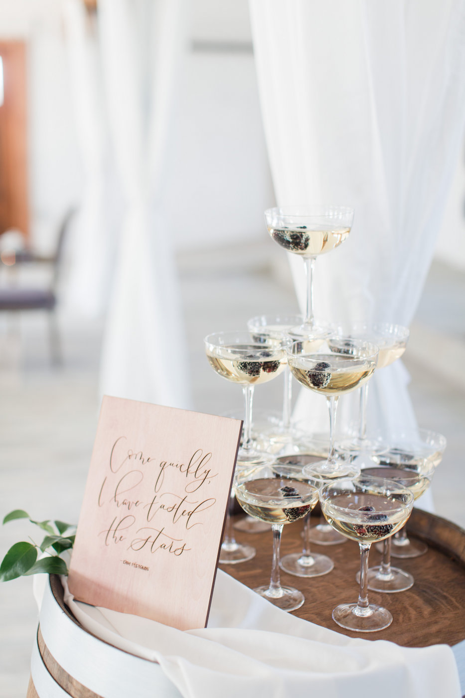 champagne tower with sign