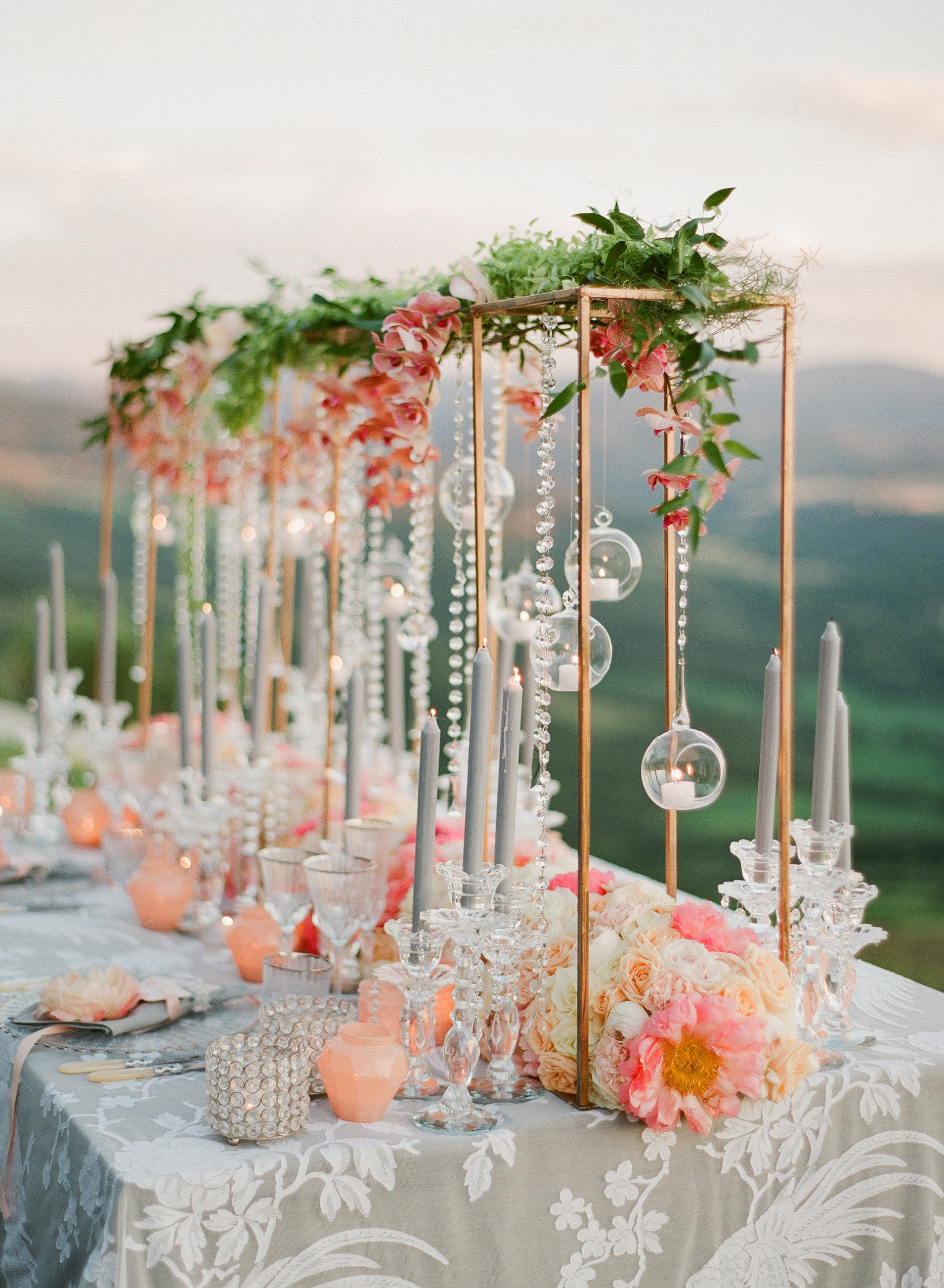 tall centerpiece with pink garden roses and ornaments