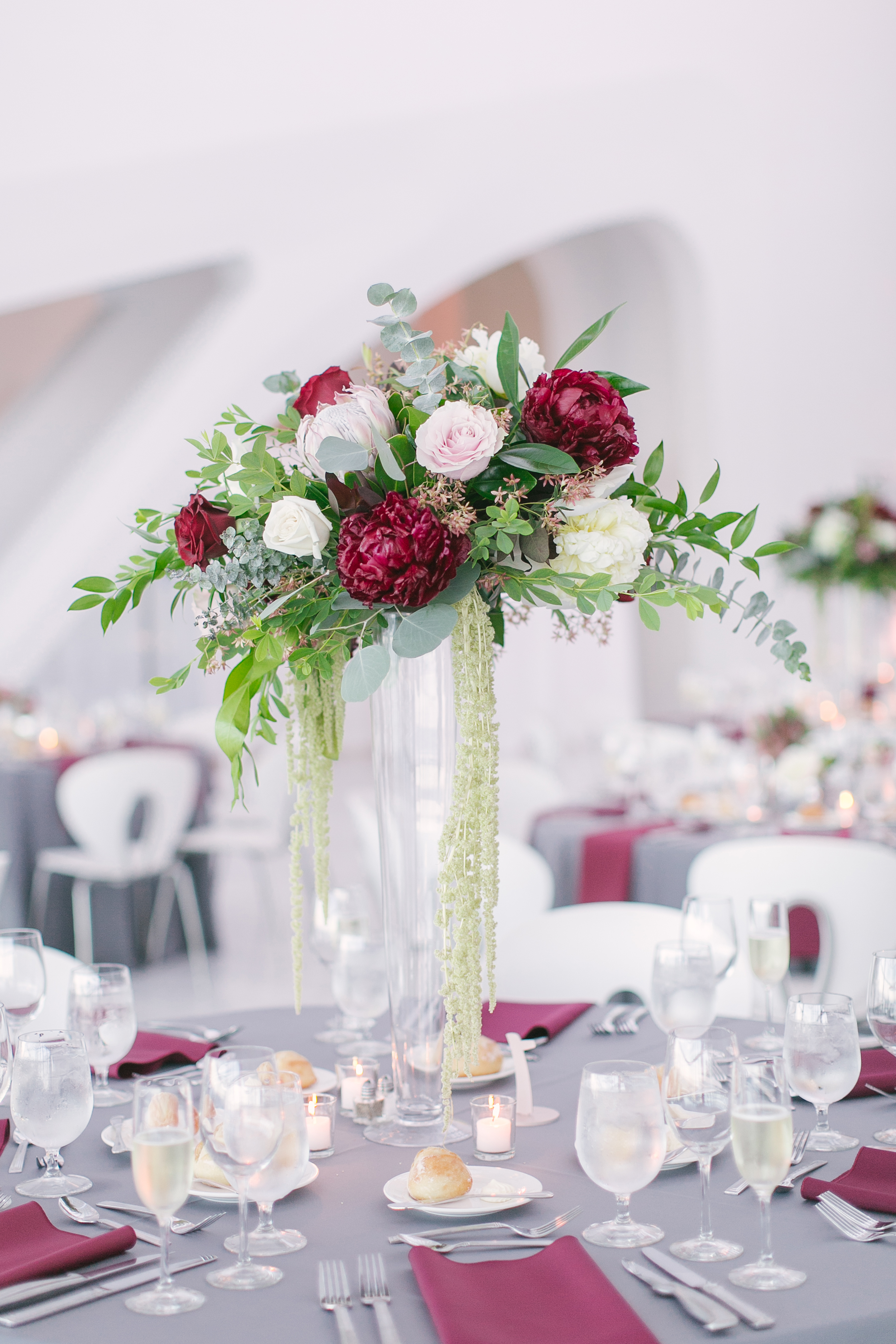 tall centerpiece with garden roses and peonies