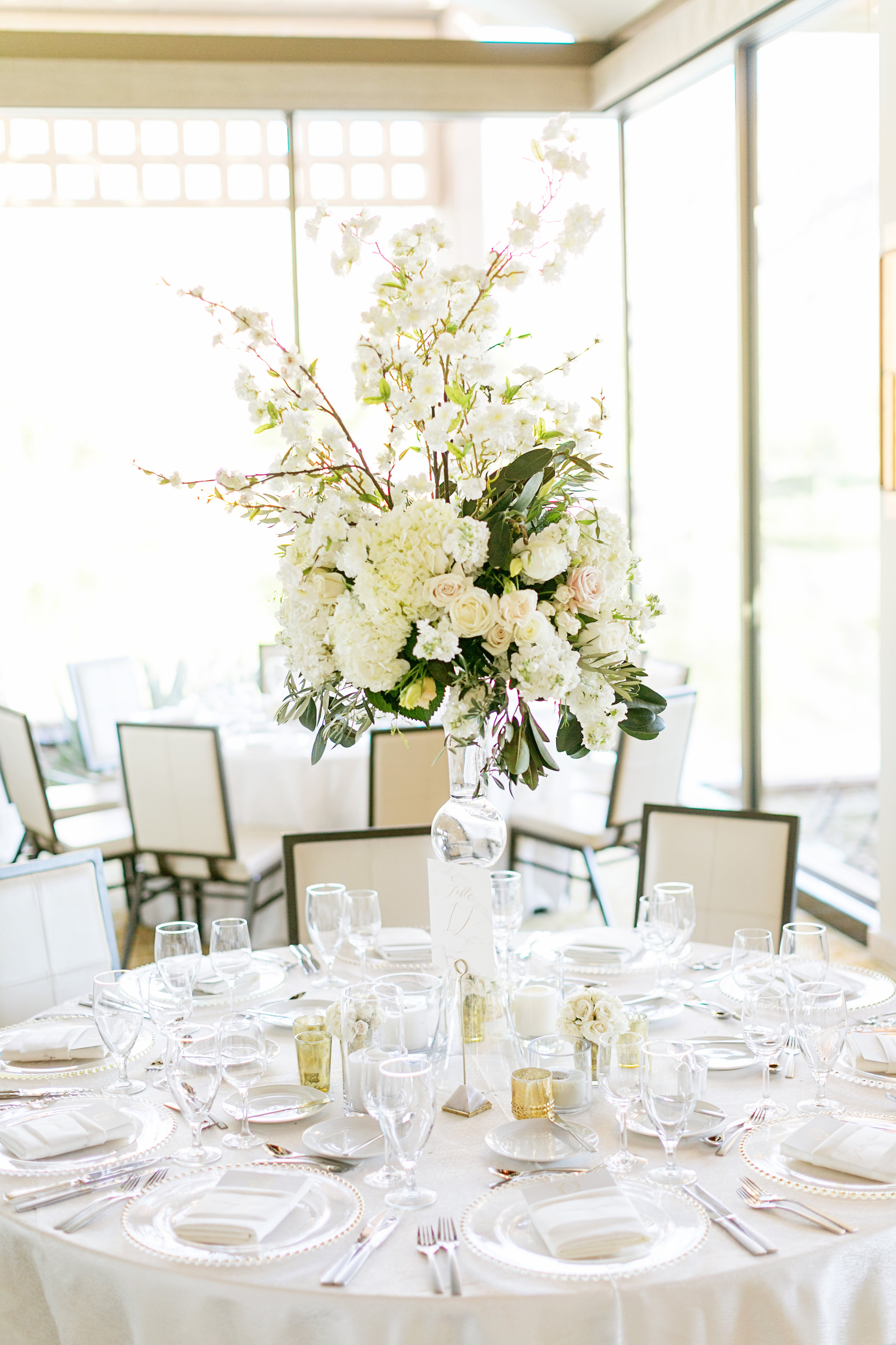 tall centerpiece with white garden roses