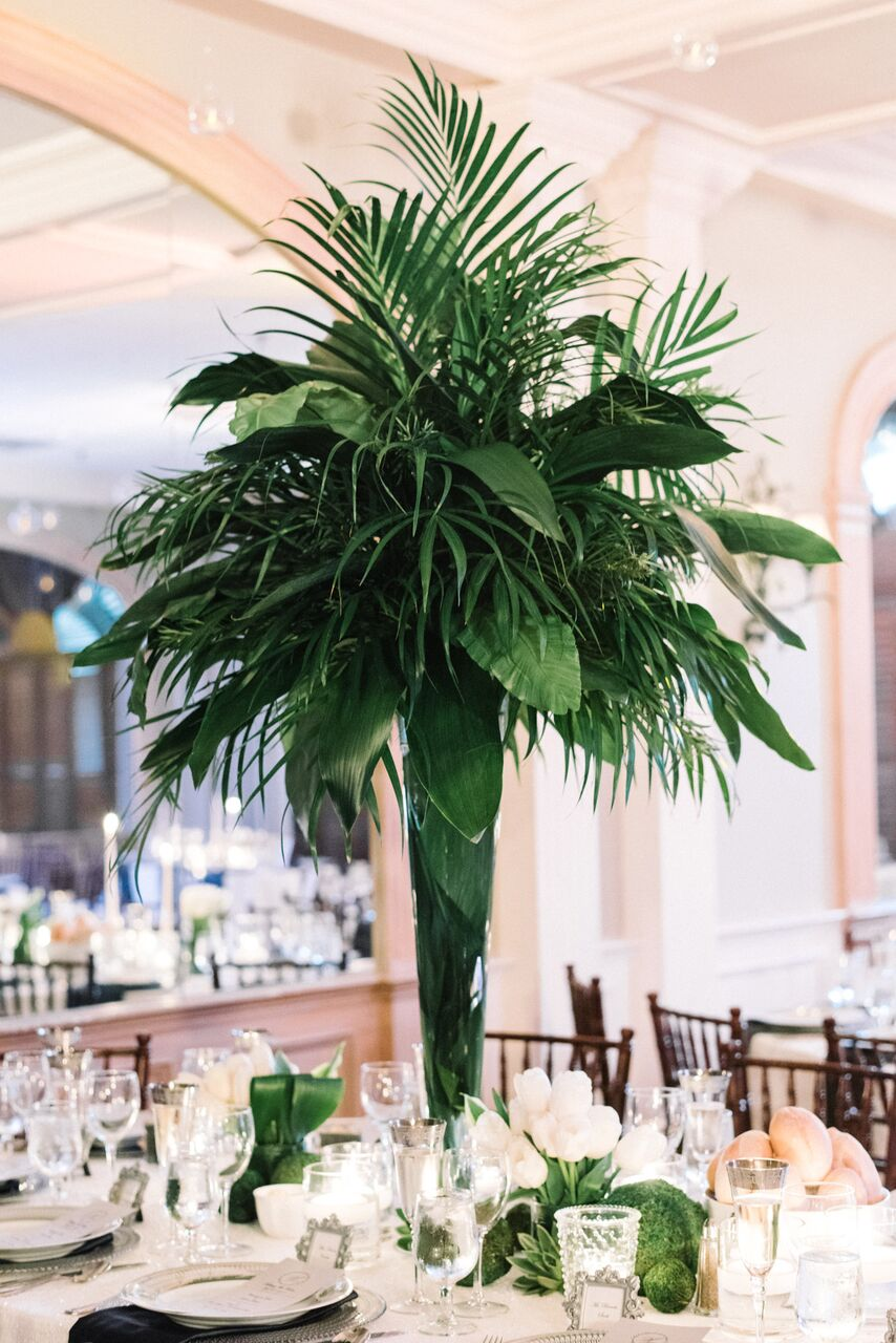 tall centerpiece with palm leaves