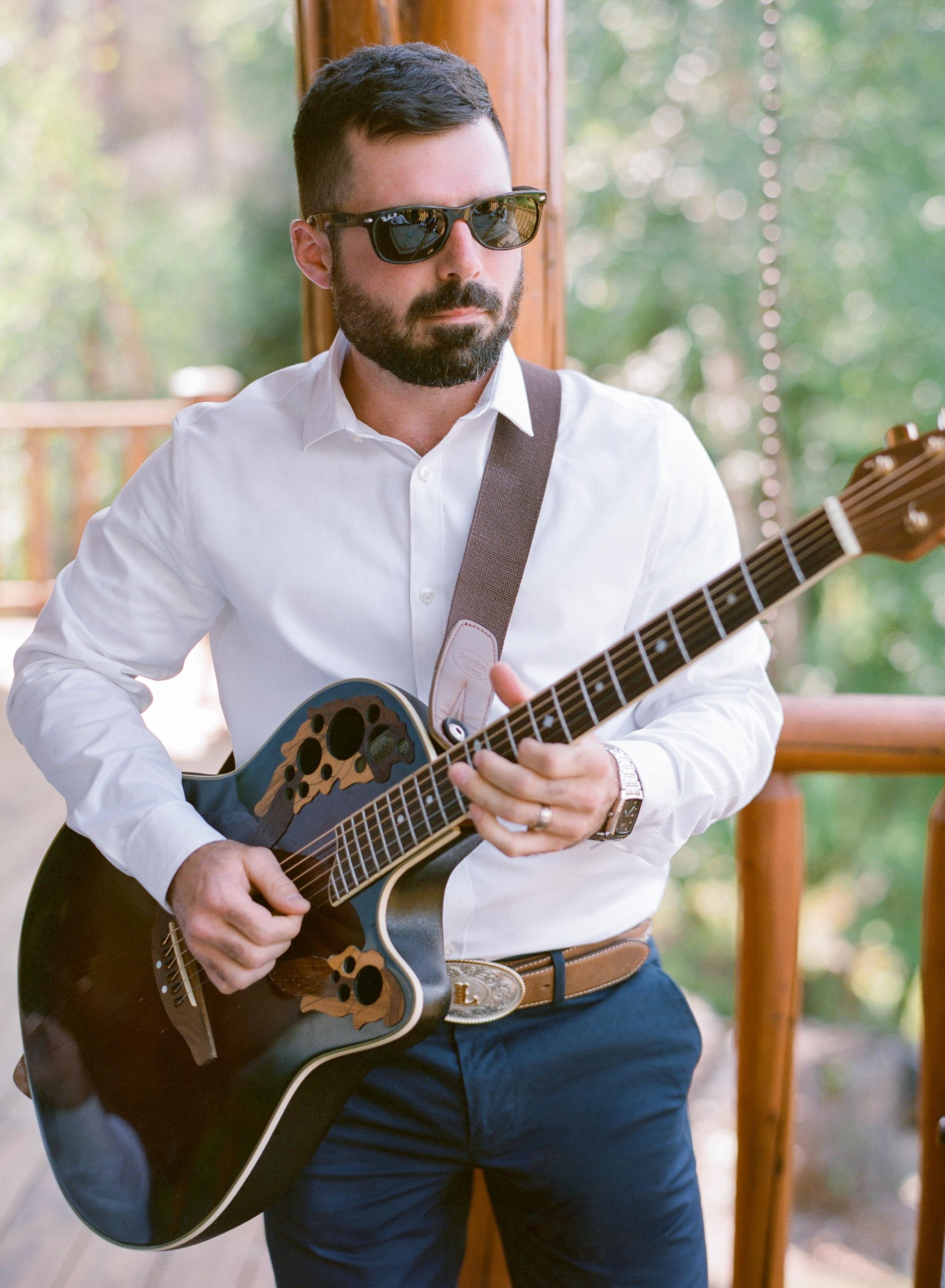 wedding guitar player sunglasses beard