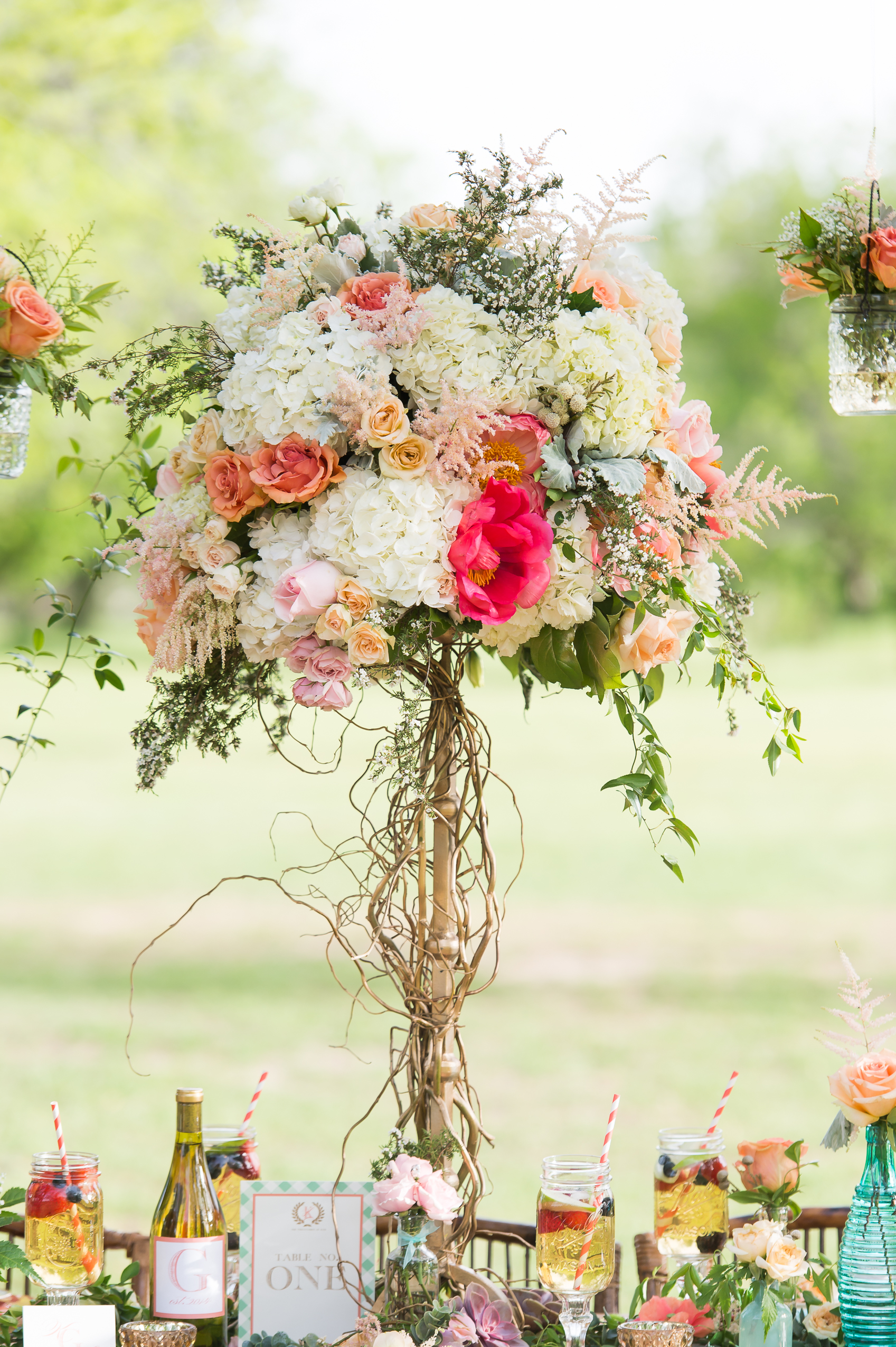tall centerpiece with hydrangeas roses and peonies
