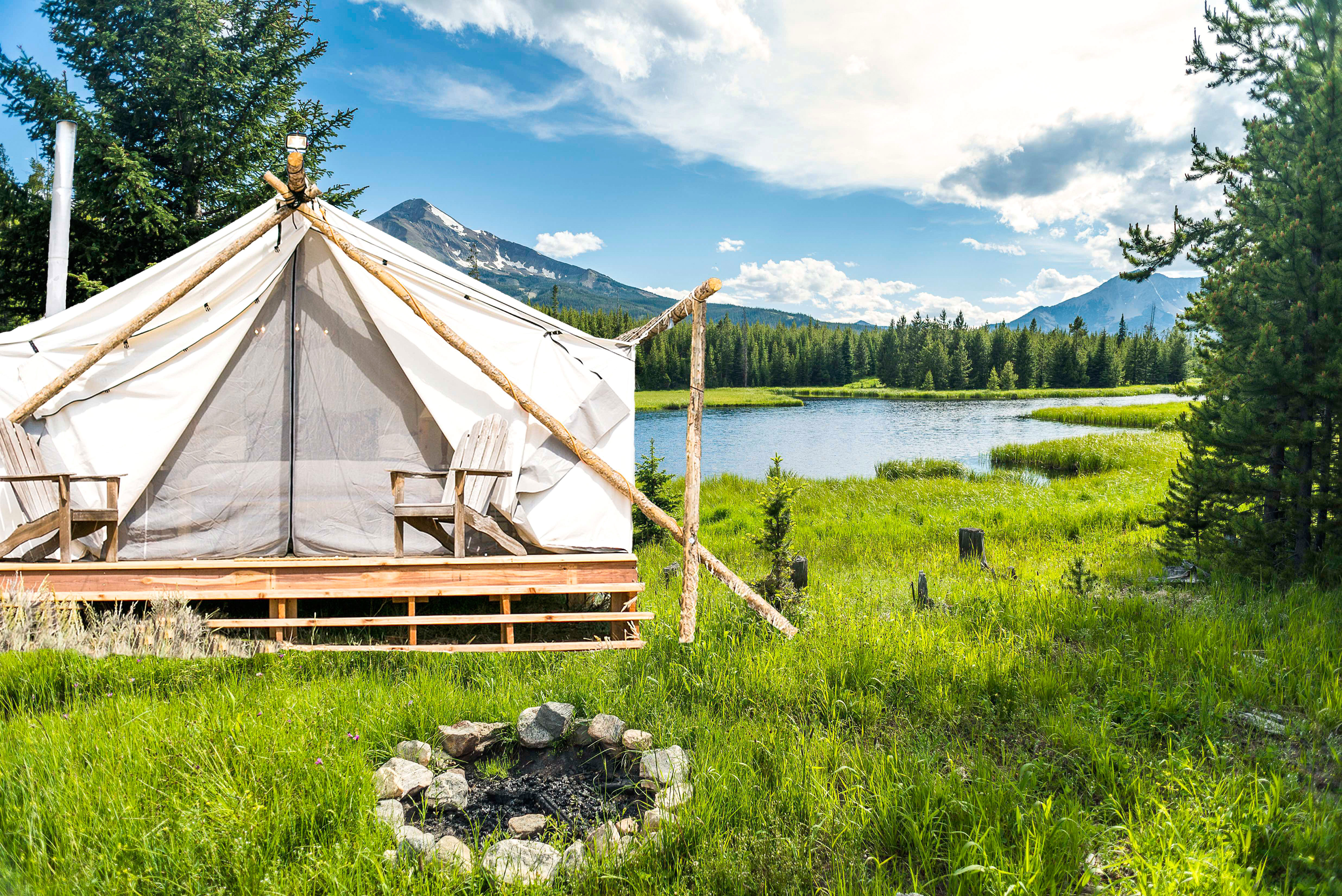 tent fireplace mountain pond yellowstone