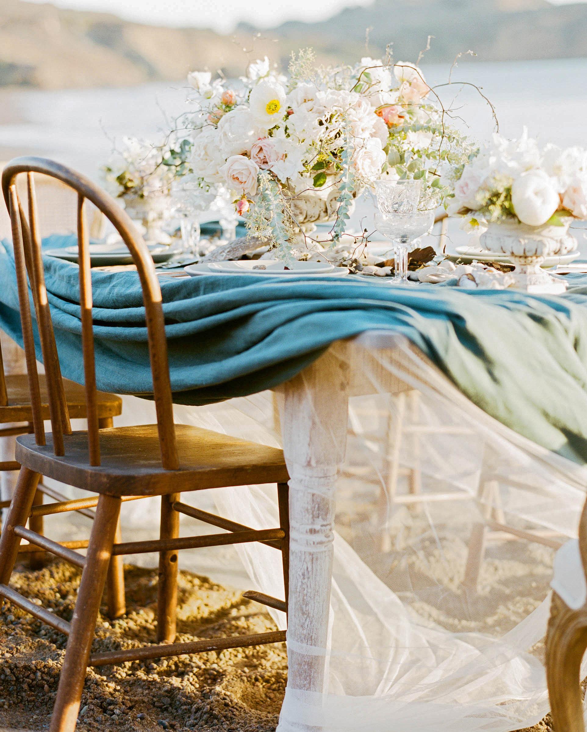tulle underneath blue linen on beachside table