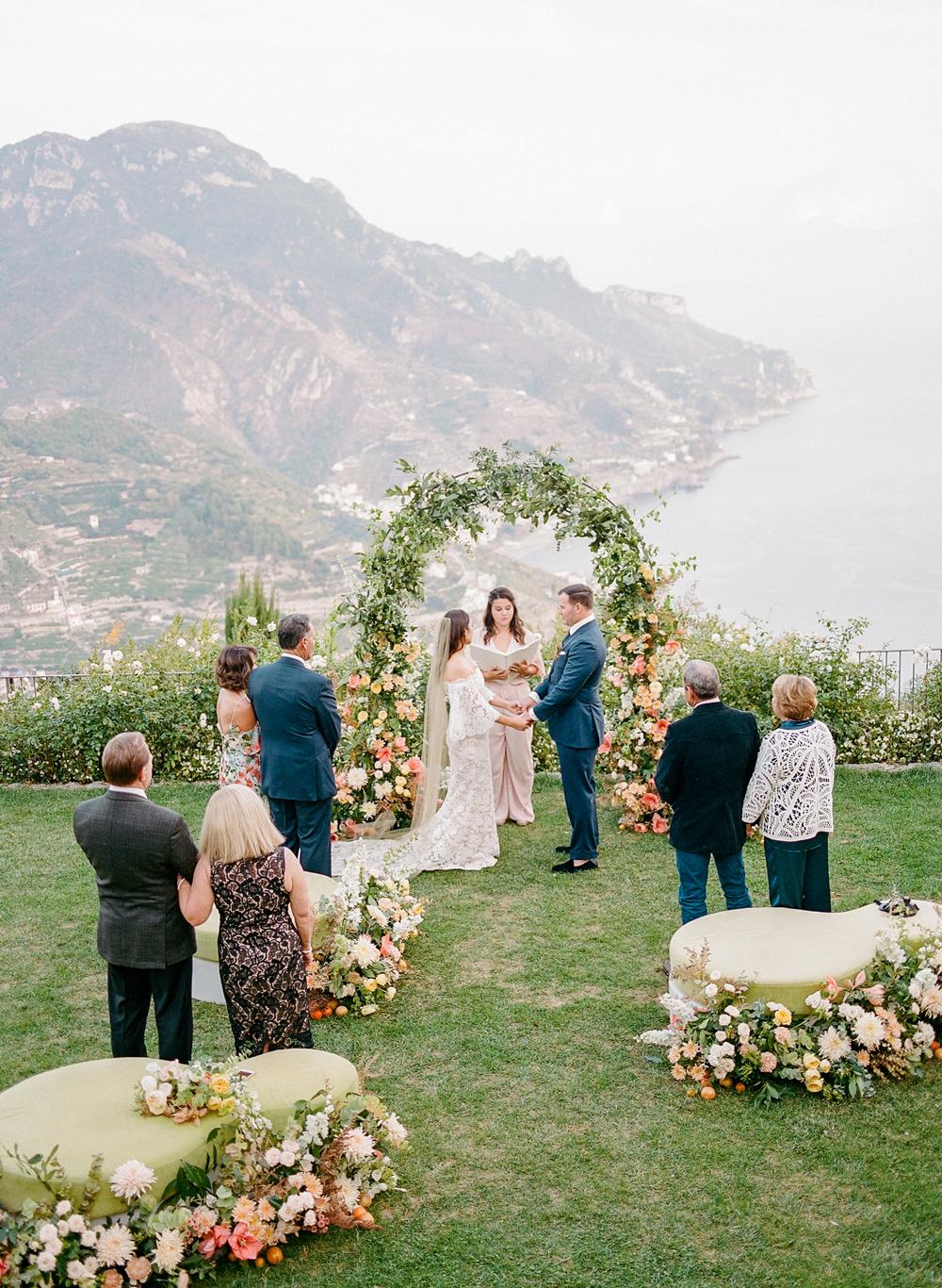floral arch outdoor wedding ceremony on Italian coast