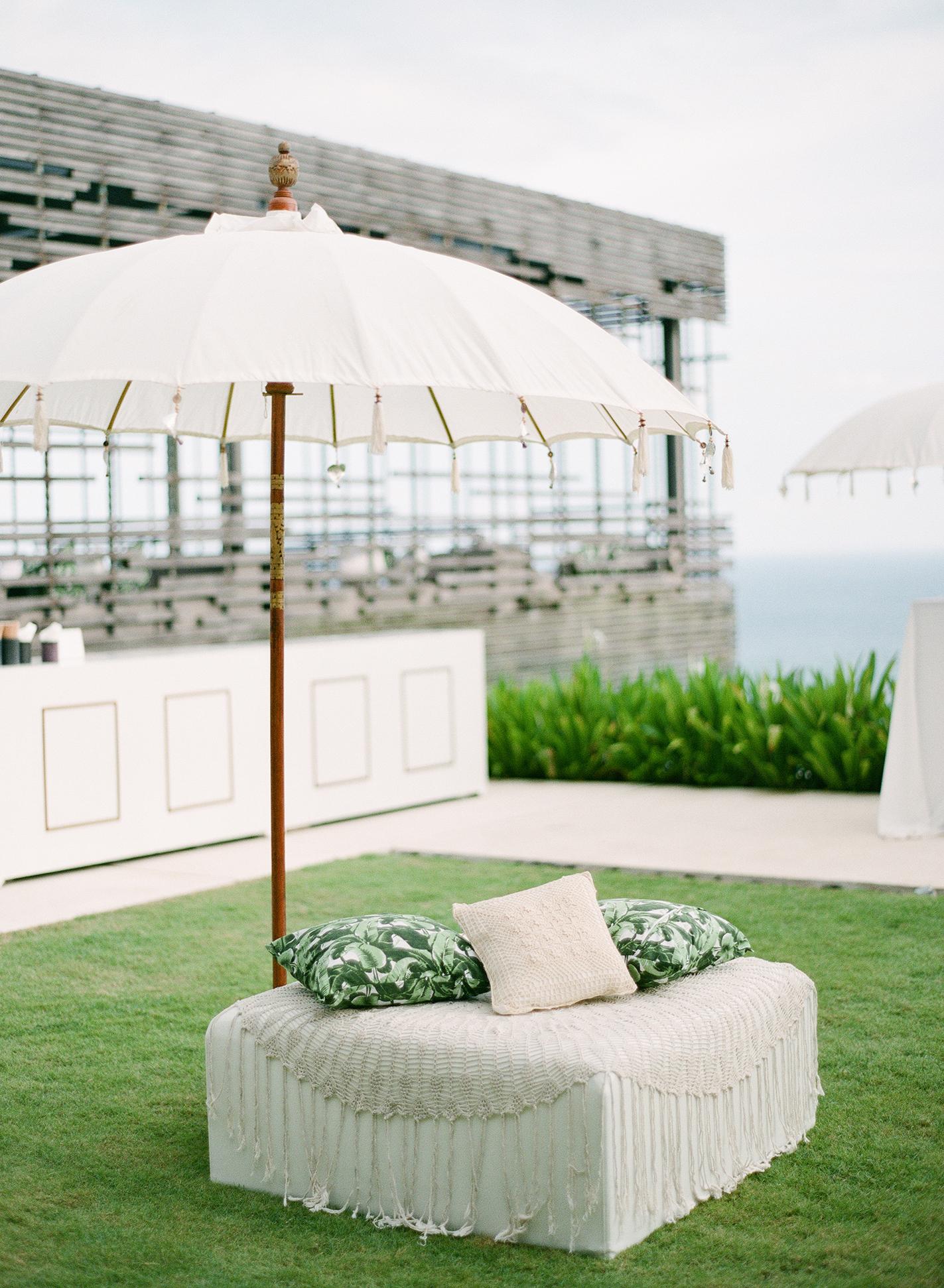 wedding lounge umbrella over white chair