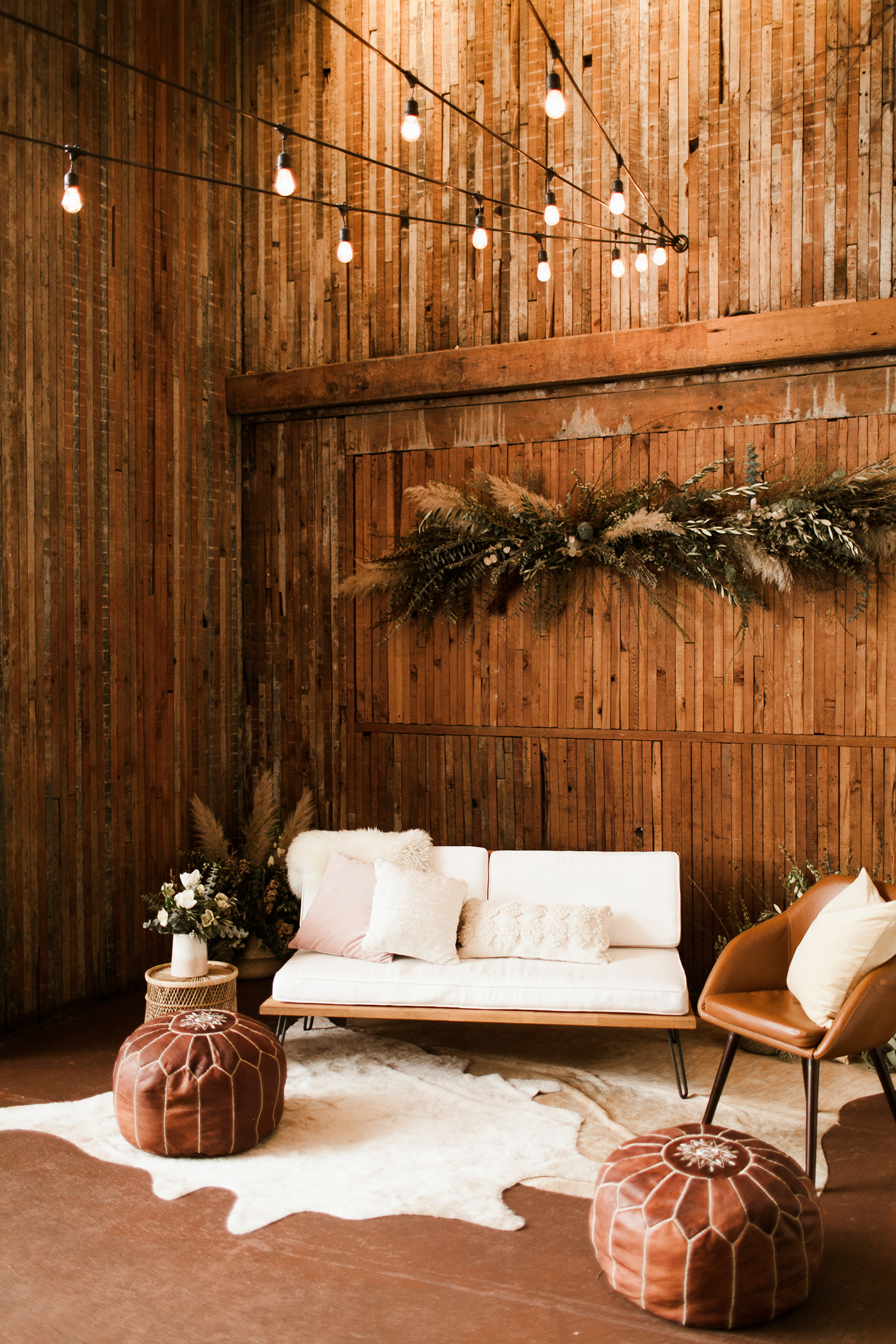 wedding lounge western leather chairs and poufs