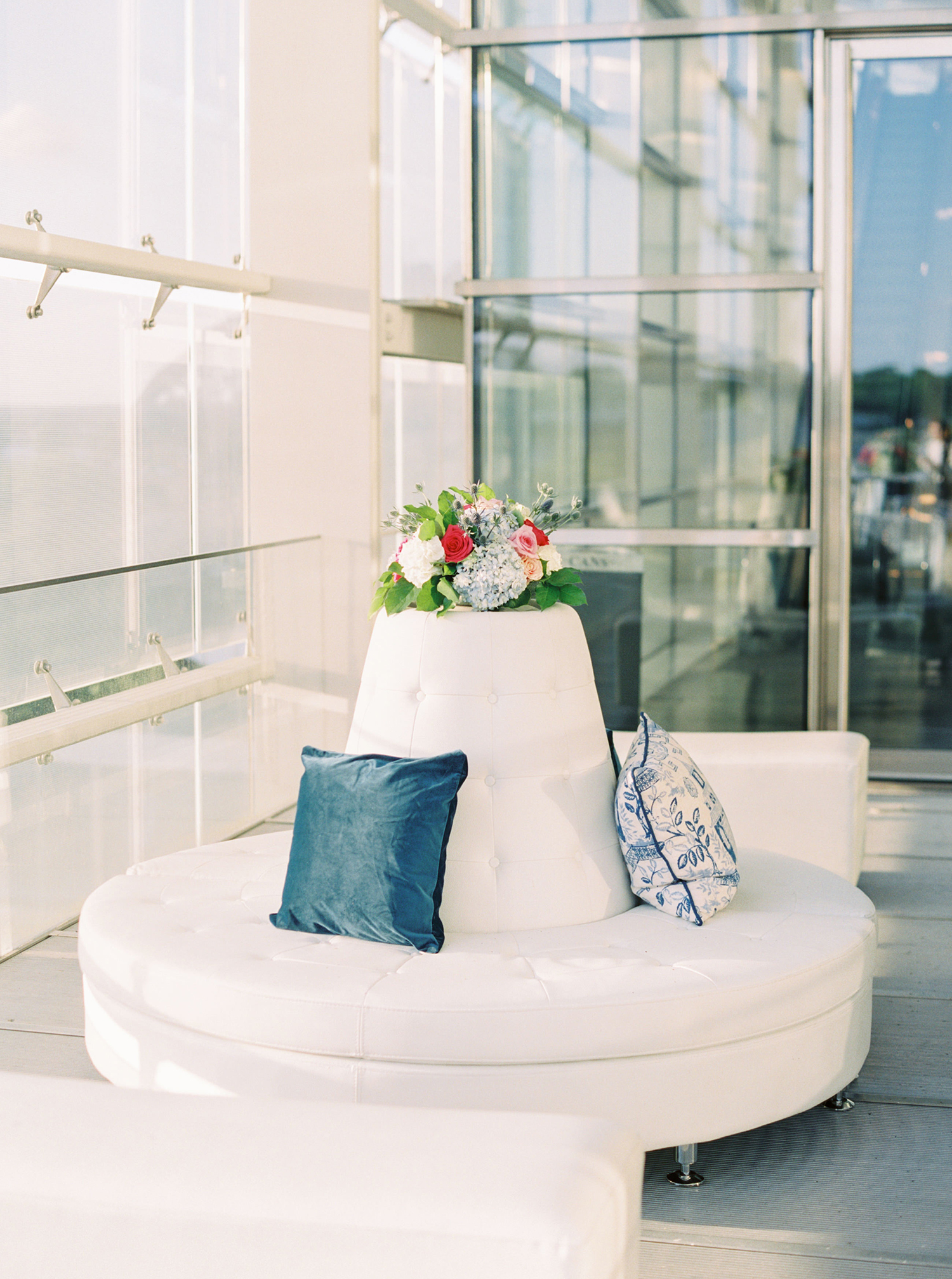 wedding lounge circular couch with blue pillows