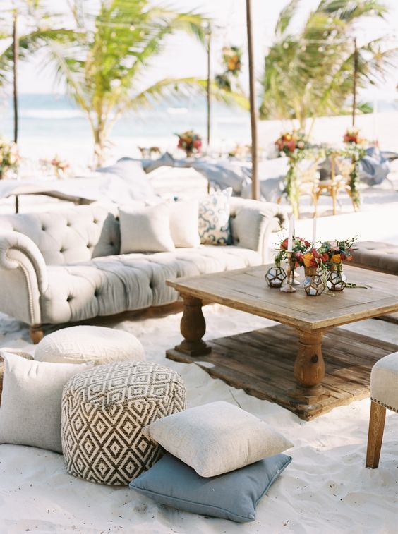wedding beach lounge with tan couches and wooden table