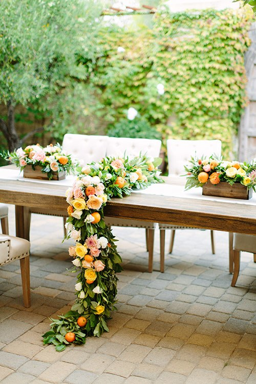 head table with citrus decorations