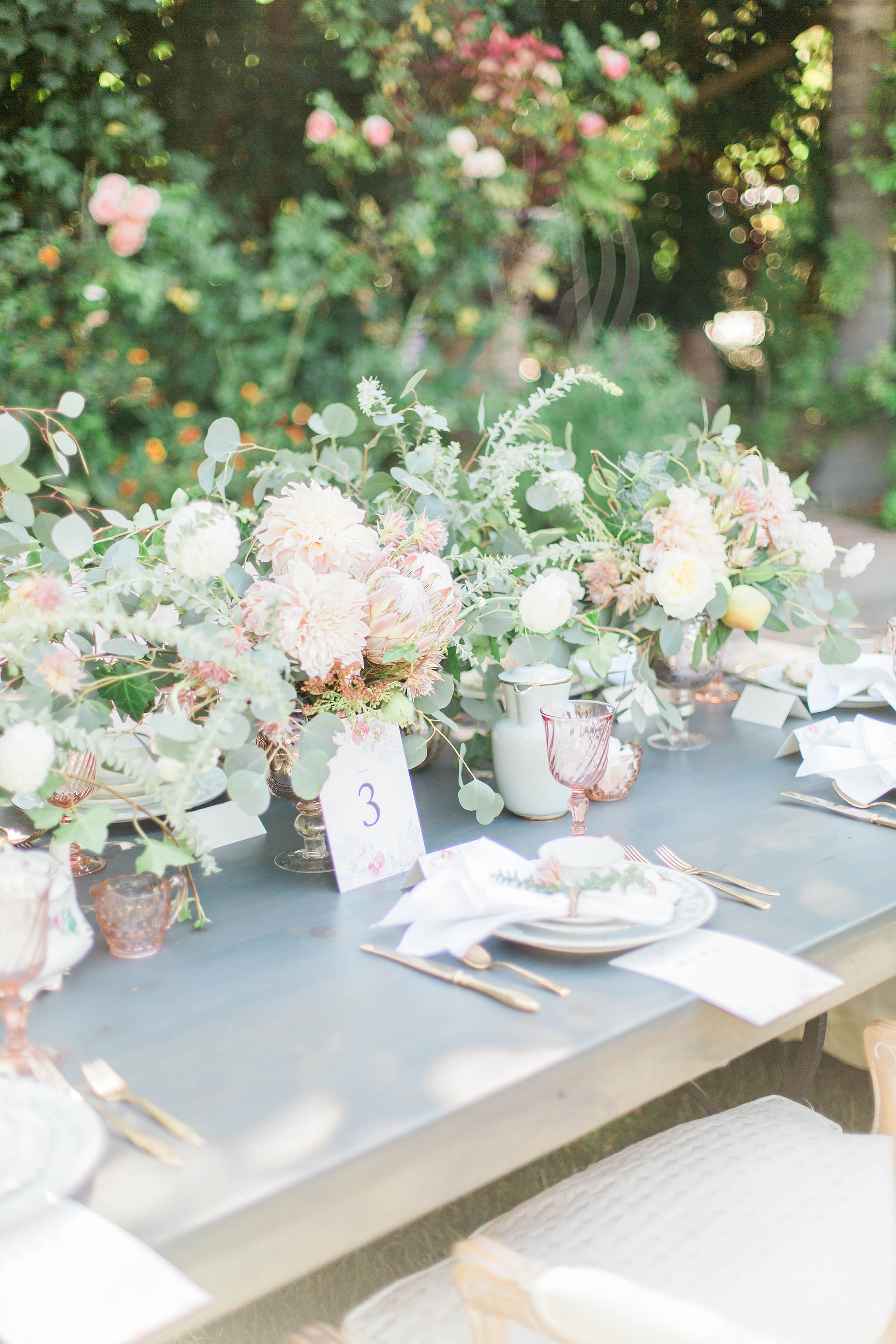Loose, Romantic Cluster Centerpieces at Outdoor Wedding