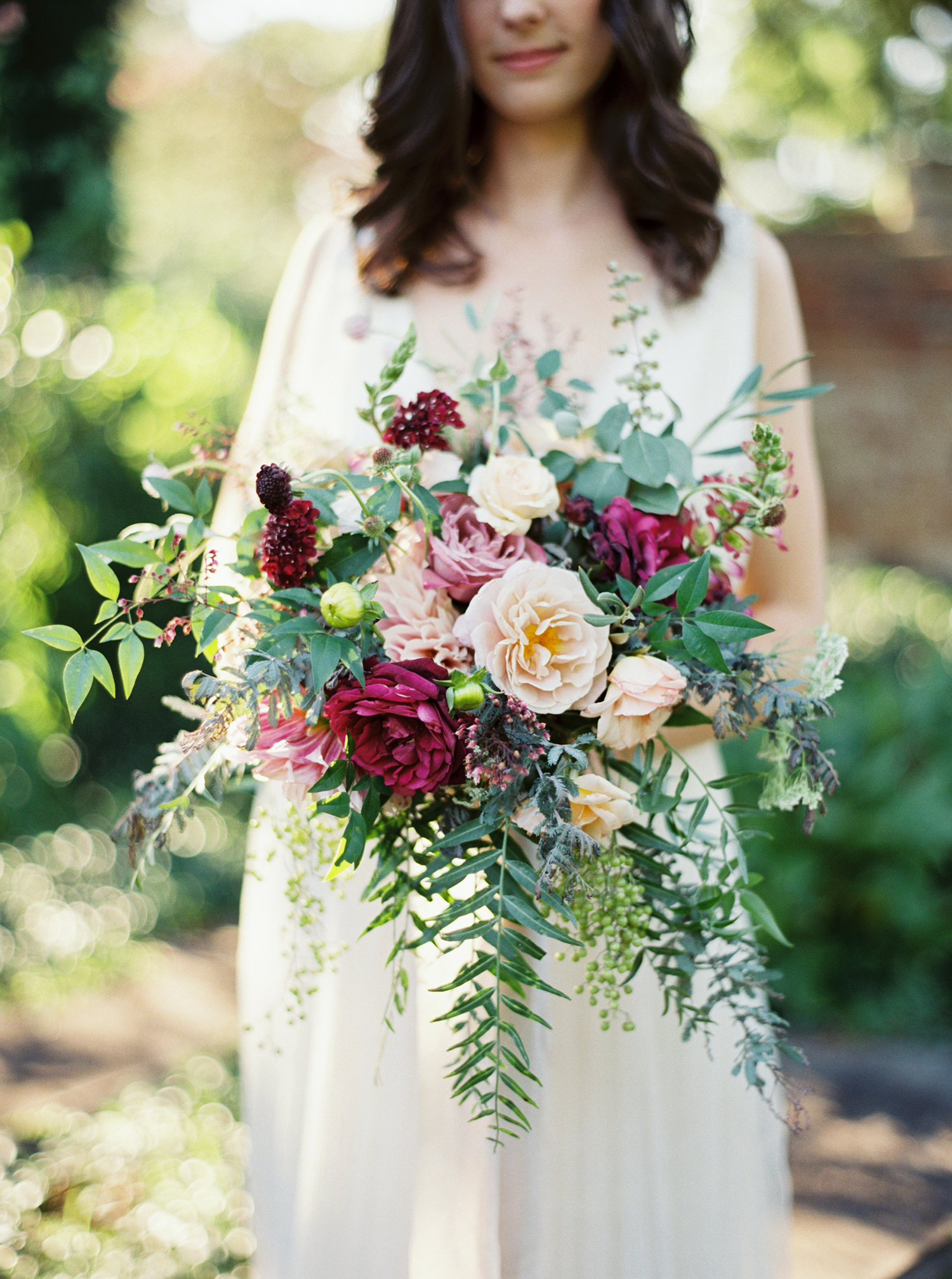 Romantic pink and burgundy rose wedding bouquet