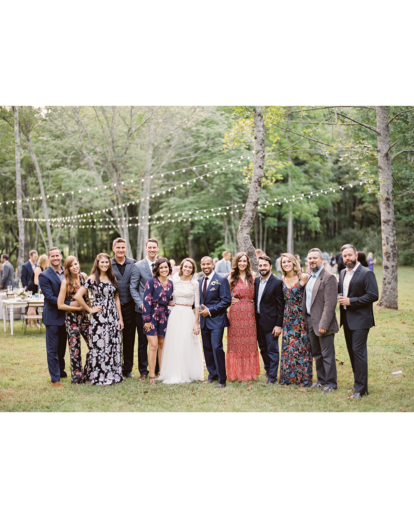 ashley and justin pose with wedding guests