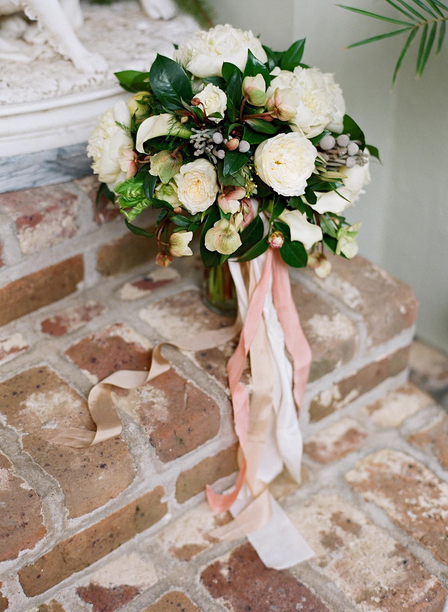 lindsay evan wedding bouquet on steps